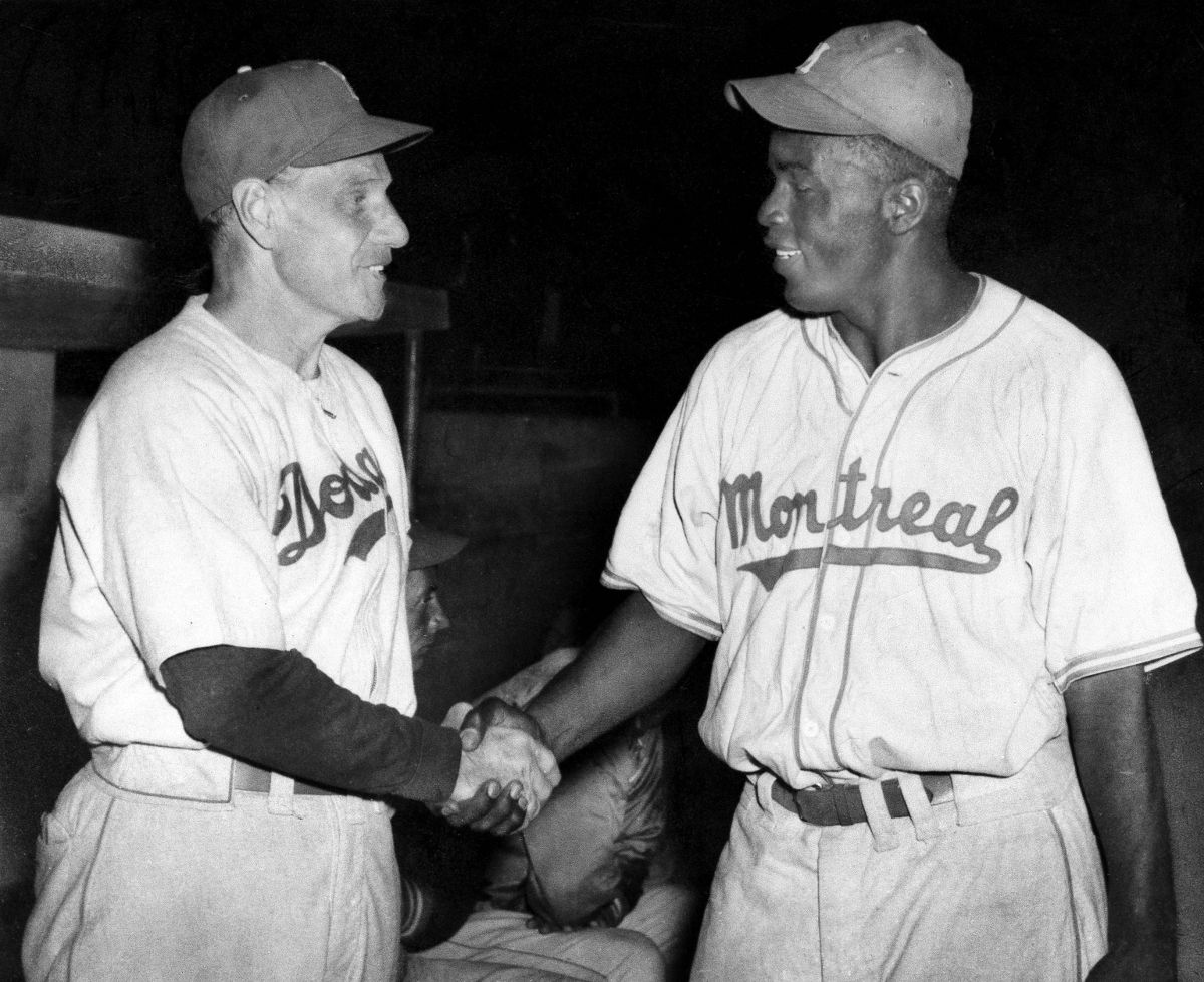 Jackie Robinson, Montreal Royals' first baseman, is shown shaking hands with Brooklyn Dodger manager Leo Durocher in March 1947 in Havana, Cuba, where the Dodgers and Royals played an exhibition game.