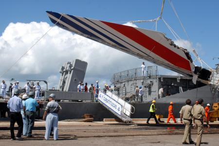 Debris of the missing Air France flight 447, recovered from the Atlantic Ocean, arrives at Recife's port