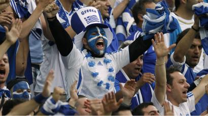 Greece's fans cheer before a national soccer team match.