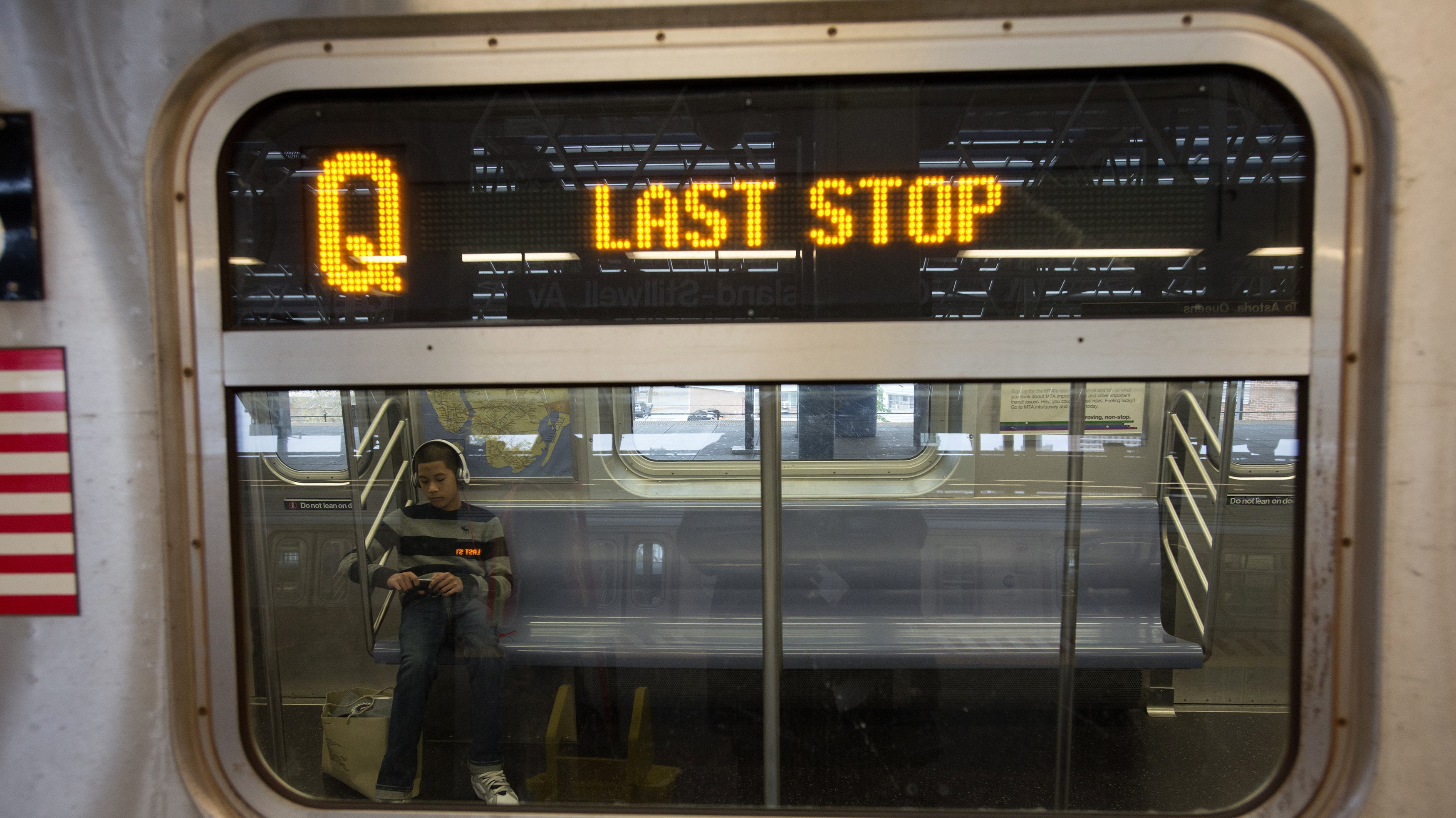 A boy sits in a New York City subway train as it enters the Coney Island station prior to a total subway shutdown at 7pm in New York, October 28, 2012.