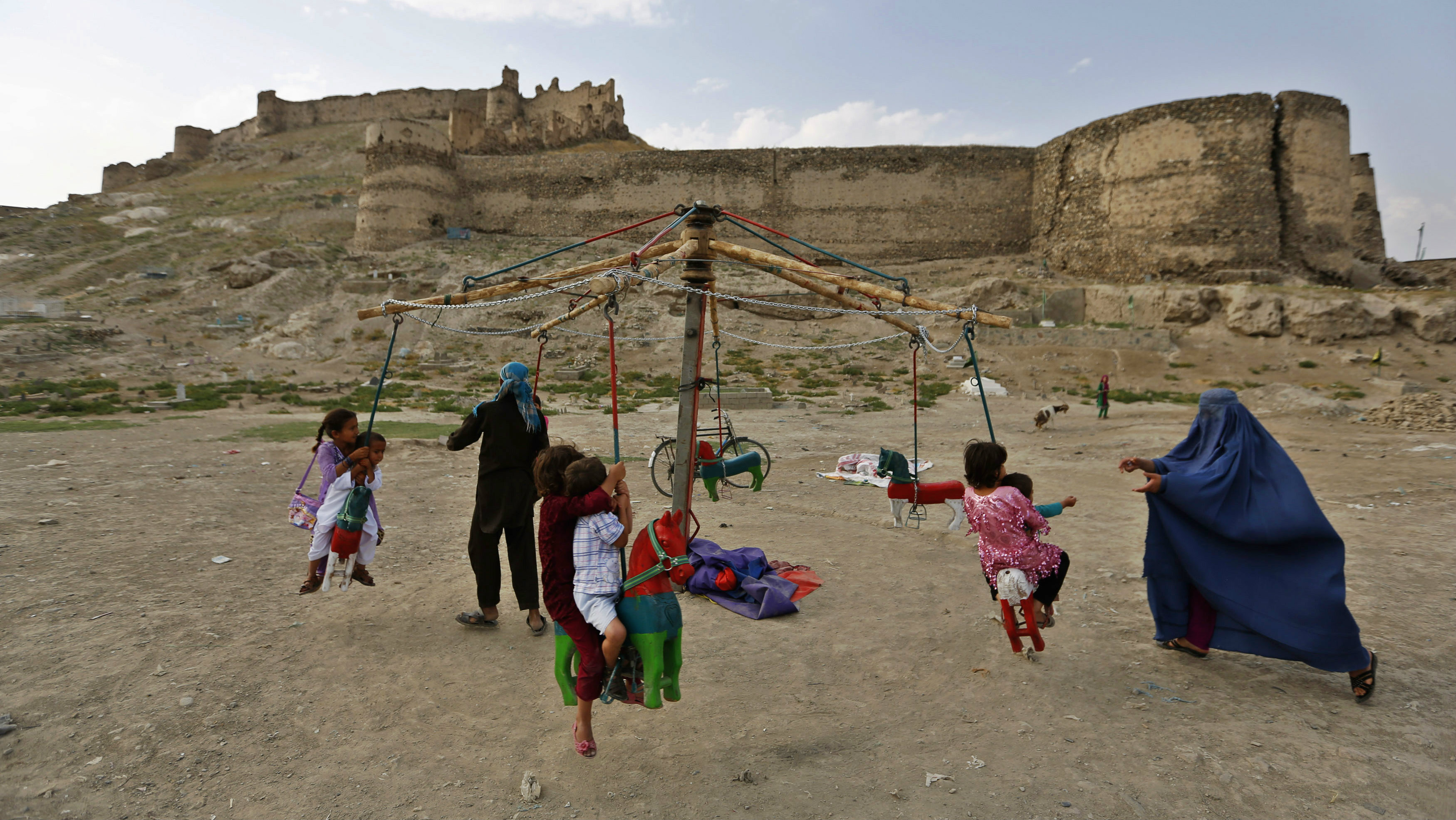 Children play on a carnival ride during Eid al-Fitr Holiday in Kabul July 31, 2014. The Eid al-Fitr festival marks the end of the Muslim holy fasting month of Ramadan.