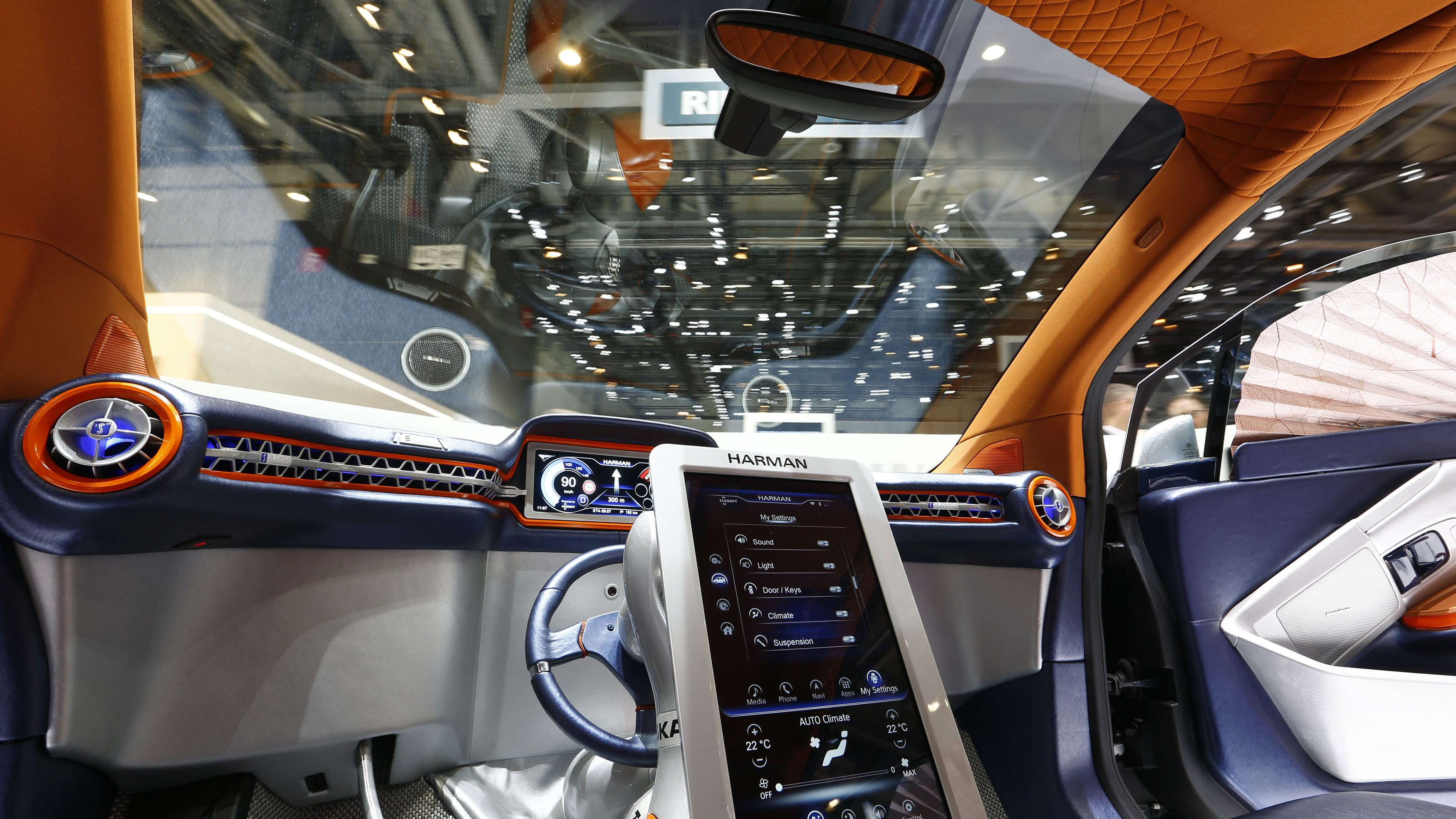 The steering wheel is seen resting in the middle of the dashboard inside a Rinspeed Budii self-driving electric city car during the second press day ahead of the 85th International Motor Show in Geneva