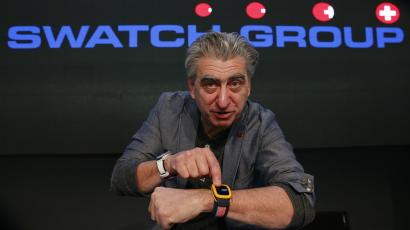 Swatch Group CEO Nick Hayek poses with the new 'Swatch Touch Zero One' during the Swiss watchmaker's annual news conference in Corgemont.