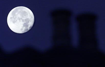 Blue moon over London chimneys