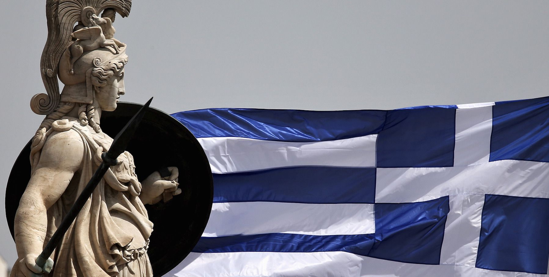 A Greek national flag flutters next to a statue of ancient Greek goddess Athena, in Athens May 21, 2015. Greek Finance Minister Yanis Varoufakis has raised a fresh furore by telling a newspaper that he taped a confidential meeting of euro zone finance ministers, drawing criticism that he was undermining Greece's efforts to secure aid from lenders. REUTERS/Alkis Konstantinidis - RTX1DYTP