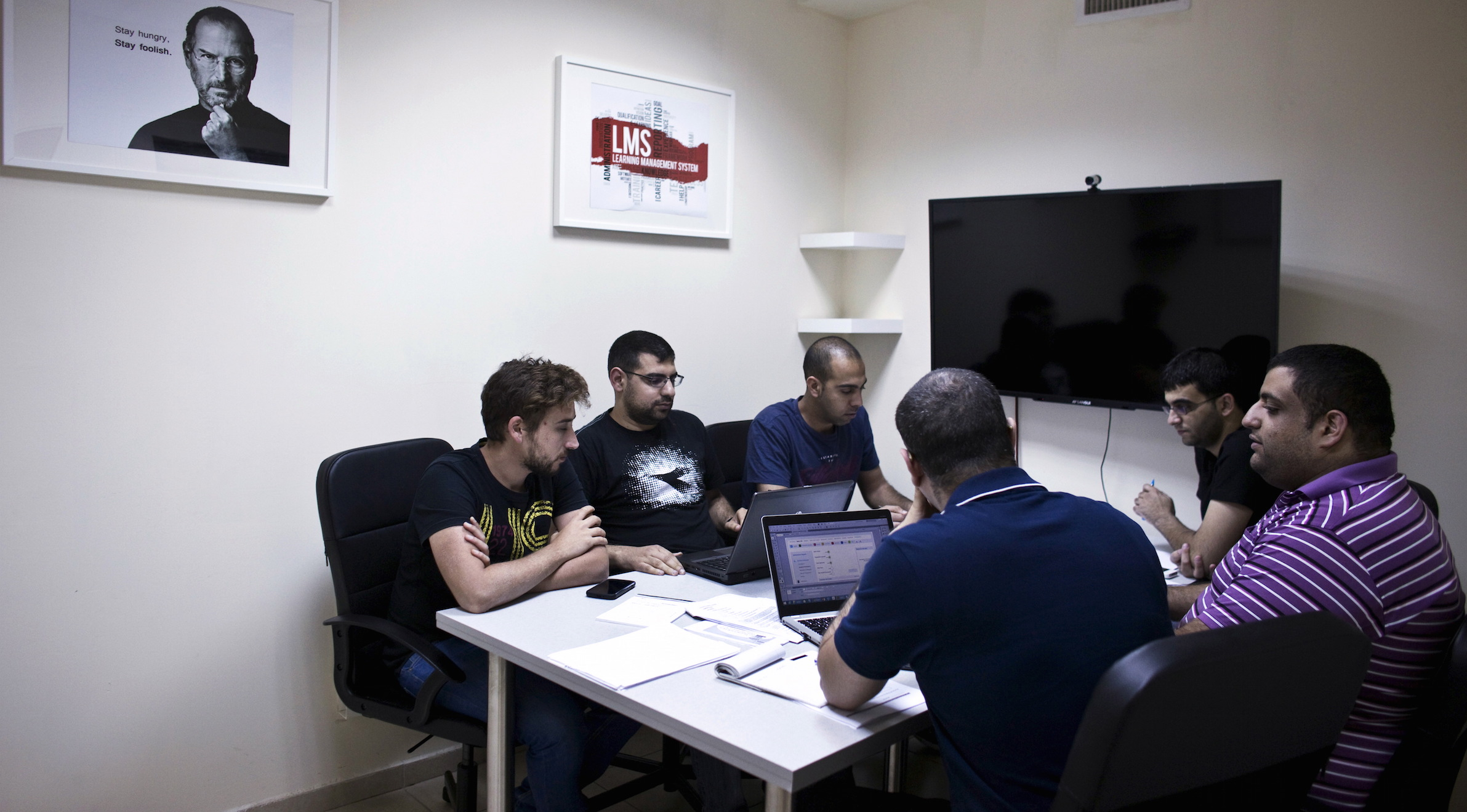 Jabbour, founder and CEO of start-up Edunation, meets with his team at their offices in Nazareth