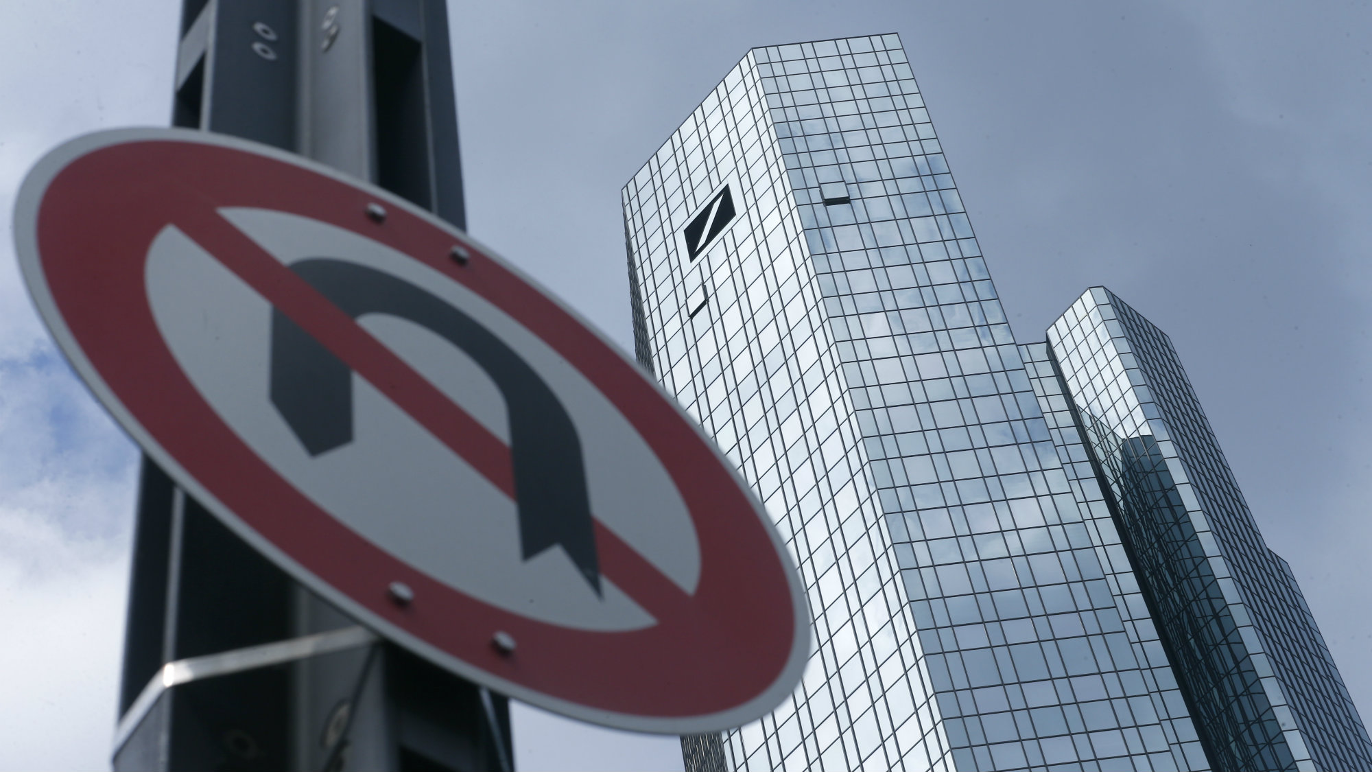 A 'No U-turn' traffic sign stands in front of Deutsche Bank headquarters in Frankfurt, Germany June 9, 2015.