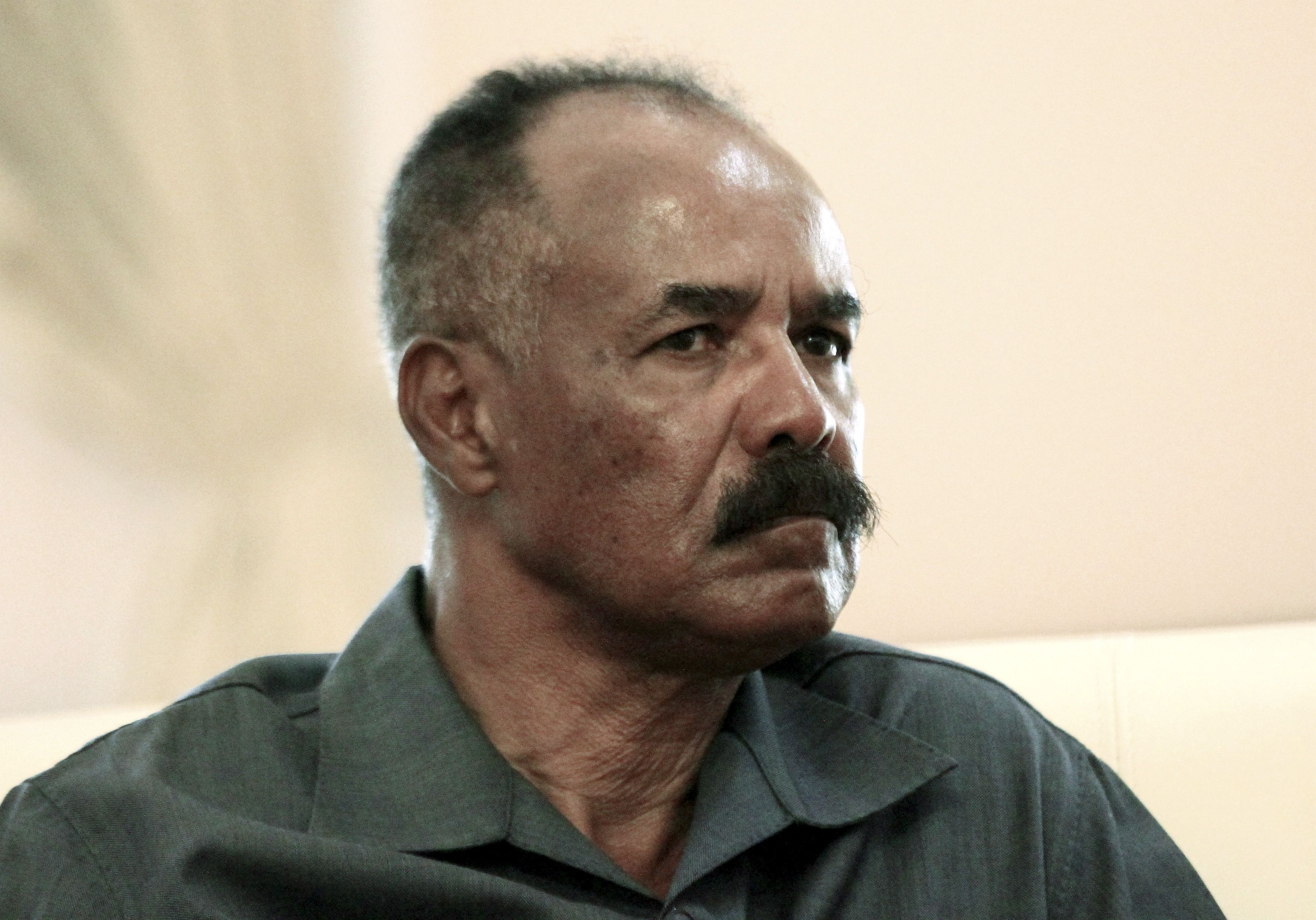 Eritrea's president Isaias Afwerki listens as he meets with Sudan's President Omar al-Bashir during his official visit in Khartoum