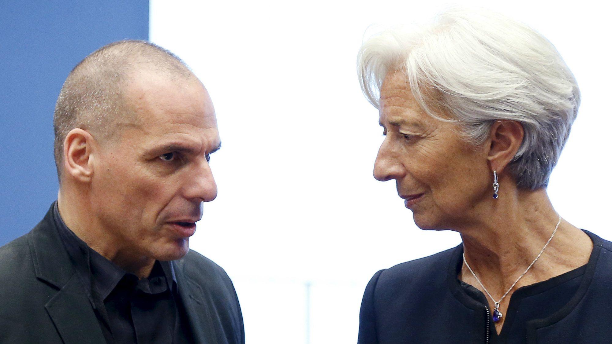 Greek Finance Minister Yanis Varoufakis talks to International Monetary Fund (IMF) Managing Director Christine Lagarde (R) during a euro zone finance ministers meeting.