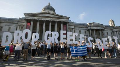 Demonstrators gather to protest against the European Central Bank's handling of Greece's debt repayments, in Trafalgar Square in London.