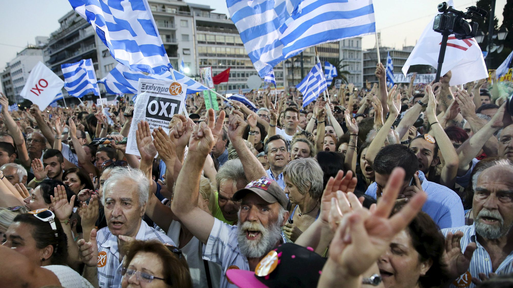 Demonstrators shout slogans during an anti-austerity rally in Syntagma Square in Athens, Greece.