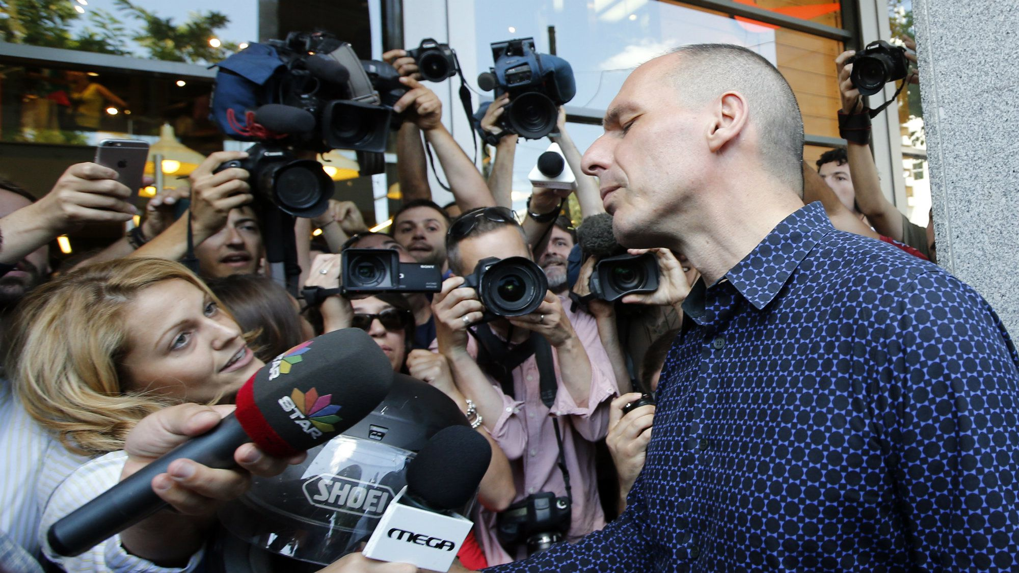 Former Greek Finance Minister Yanis Varoufakis addresses the media as he leaves the Finance Ministry in Athens.
