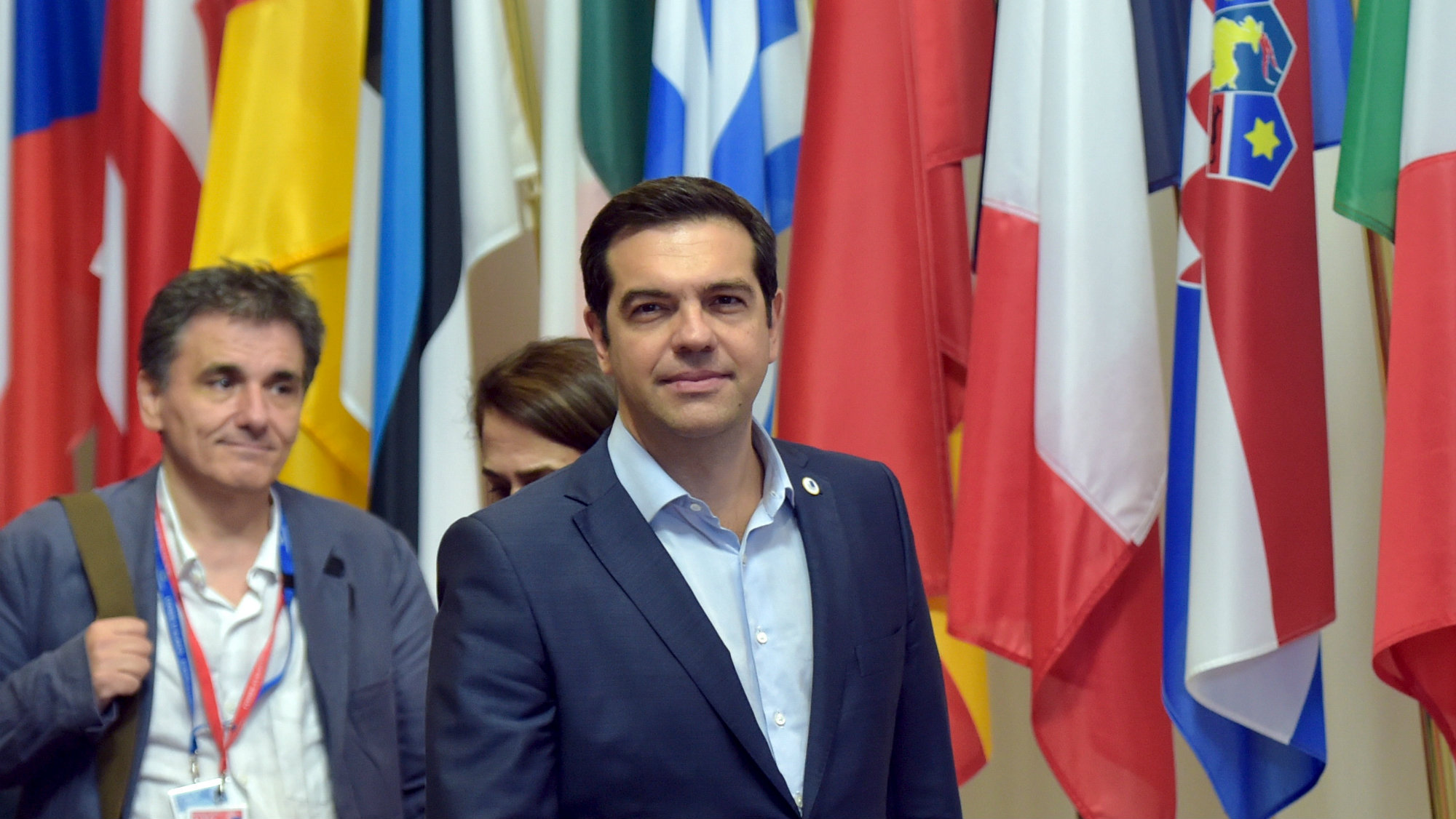 Greece's Prime Minister Alexis Tsipras (C) and Greek Finance Minister Euclid Tsakalotos (L) leave a euro zone leaders summit in Brussels, Belgium, July 13, 2015.