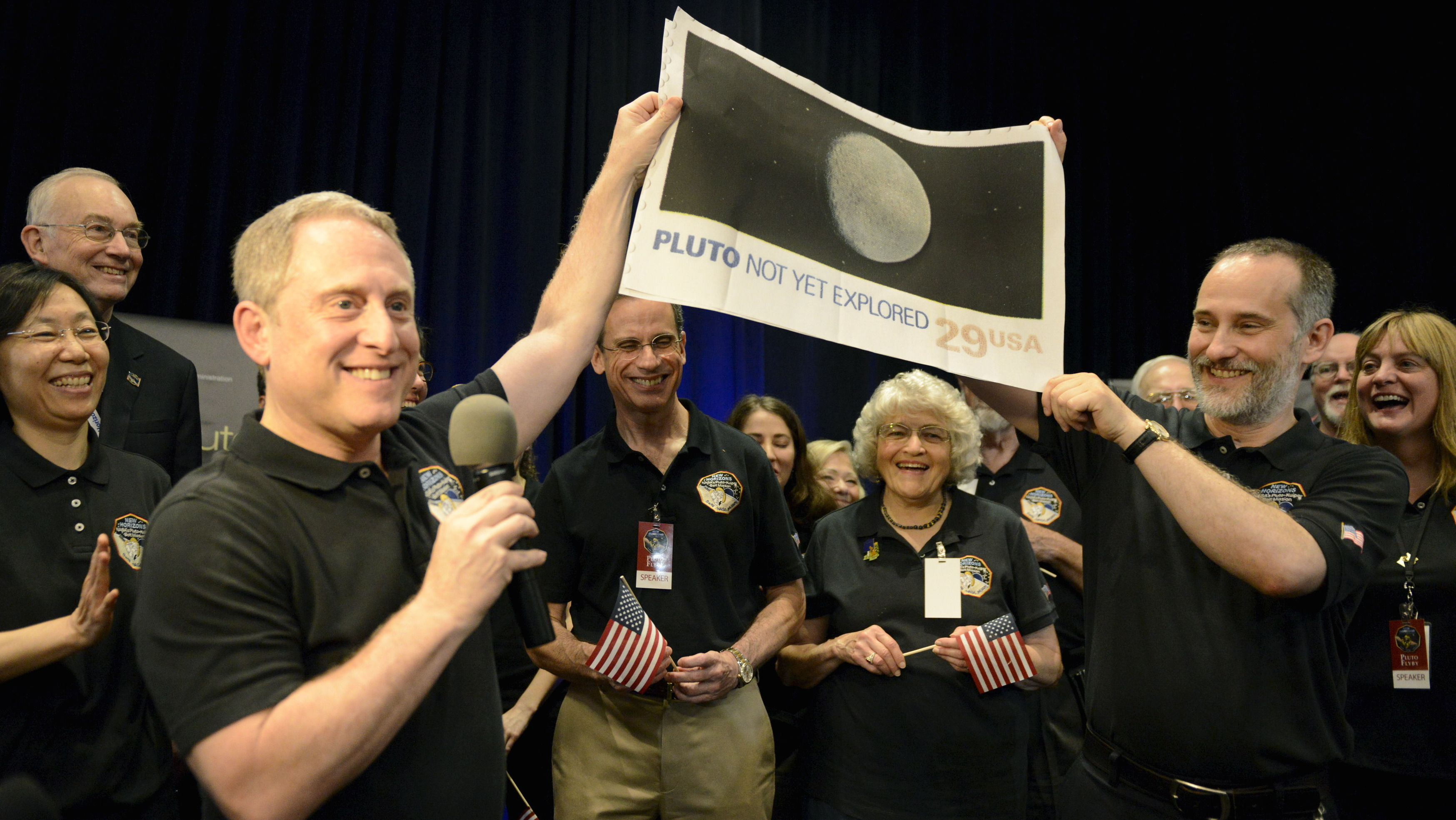 NASA officials cheer New Horizons spacecraft's flyby of  Pluto at the Applied Physics Laboratory