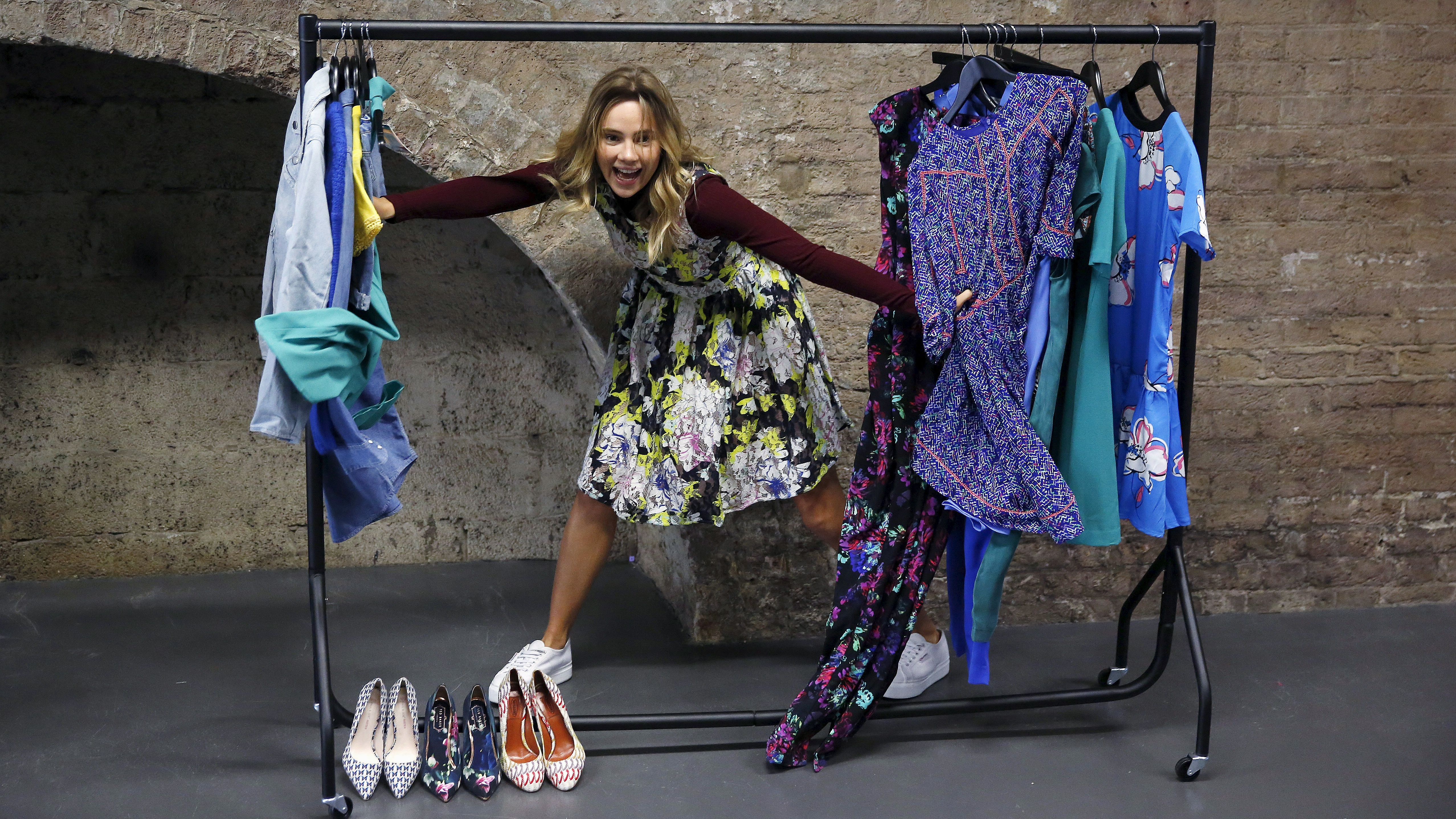 Amazon Fashion European Brand Ambassador Suki Waterhouse poses for photographers at the launch of the Amazon Fashion Photography Studio in east London, Britain July 23, 2015. Amazon's new 46,000 square foot fashion photography studio will produce more than half a million images over the next 12 months to support its rapidly growing fashion business.
