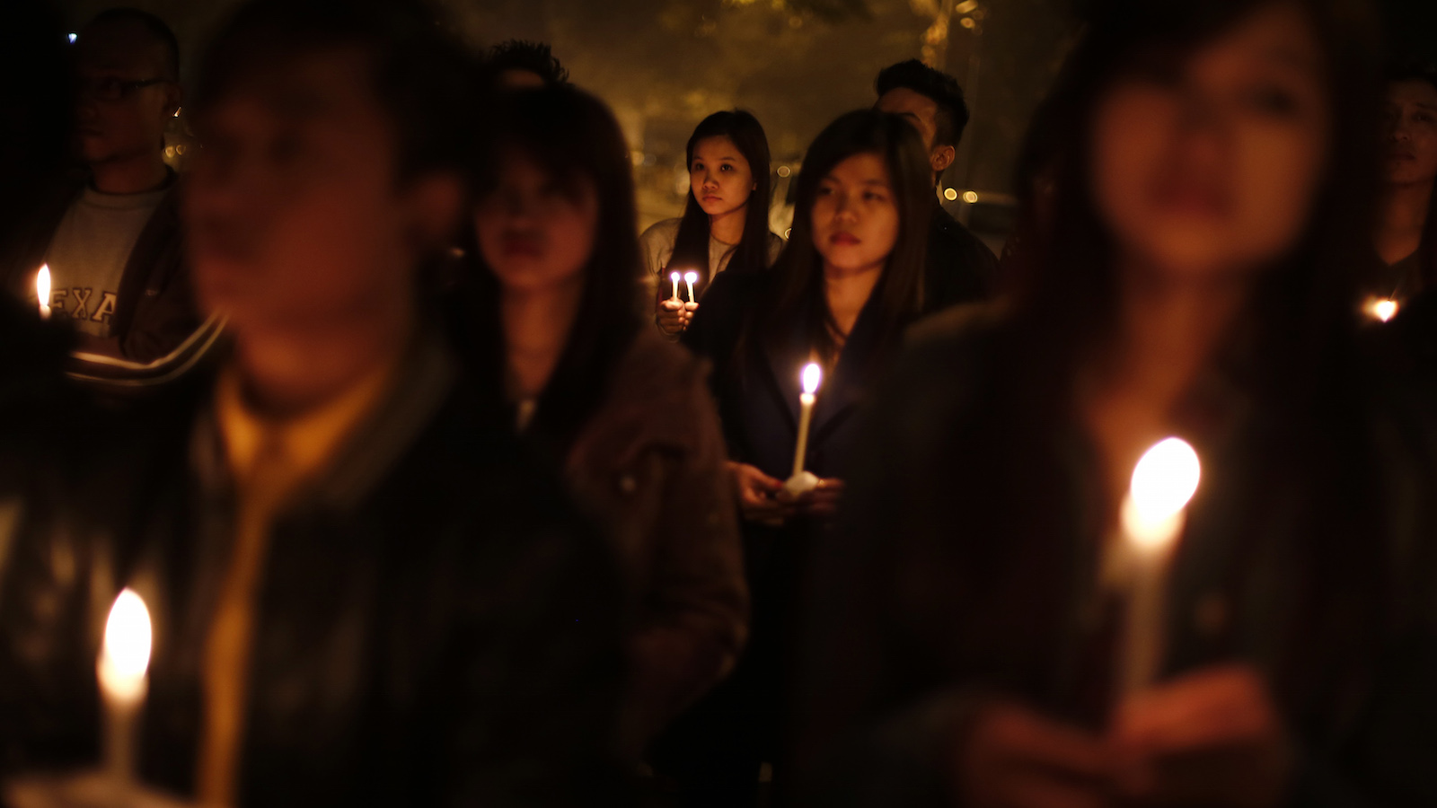 Students from northeast India hold placards during a candlelight vigil in New Delhi February 2, 2014. Hundreds of students on Sunday protested against the beating of an university student from India's northeast, who was allegedly beaten to death by shopkeepers in New Delhi following a row over his appearance and clothing, local media reported.