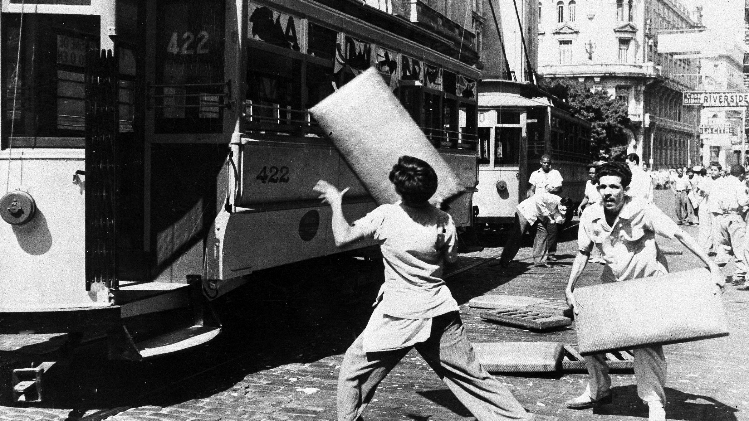 Students throw car seats back into a street car during a demonstration in Havana, Cuba, Feb. 10, 1948. The demonstrators were sympathizing with Guantanamo, Cuba students who are on a hunger strike for a new school building.