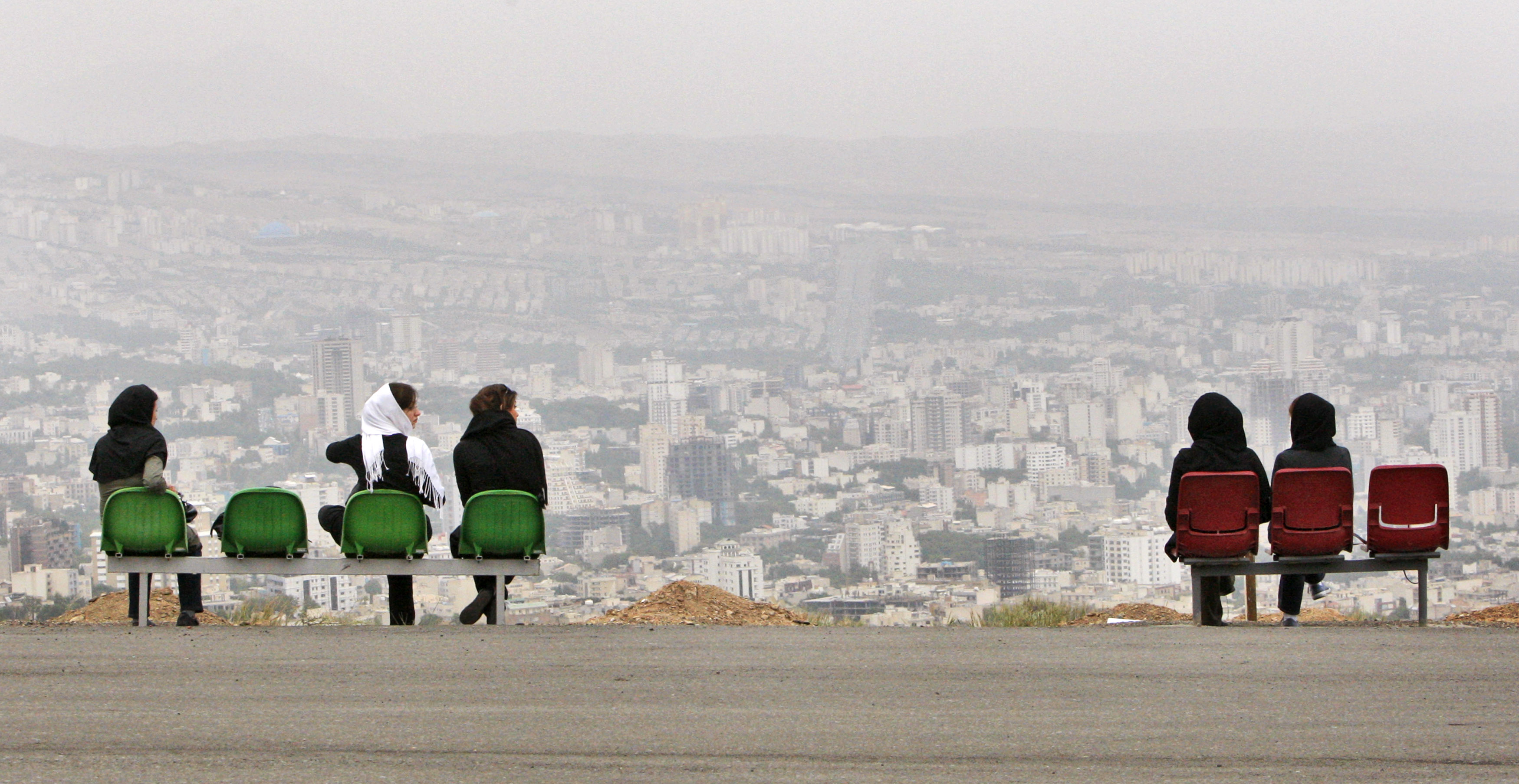 Iranian women look out onto northern Tehran