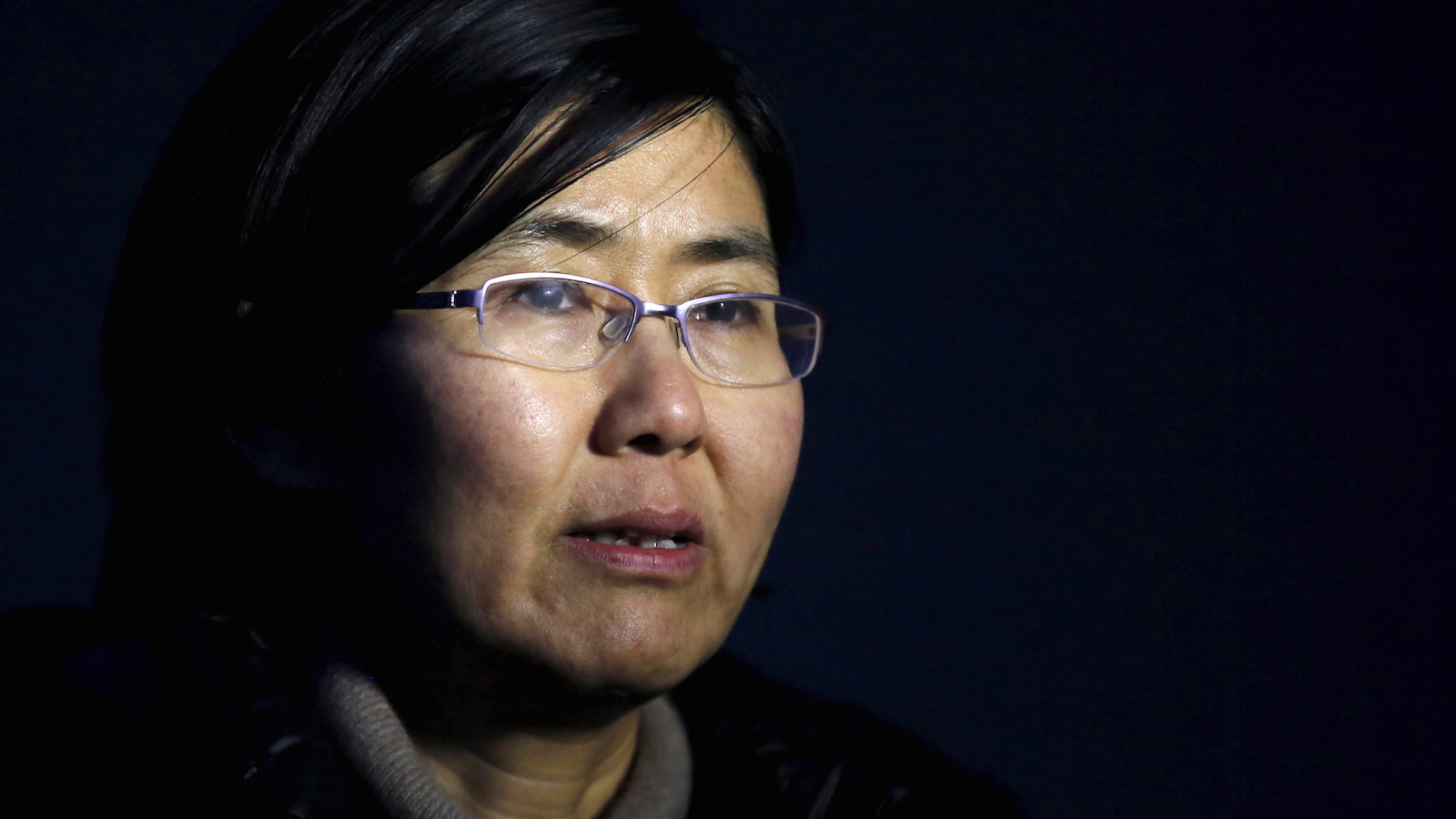 Wang Yu talking during an interview with Reuters in Beijing