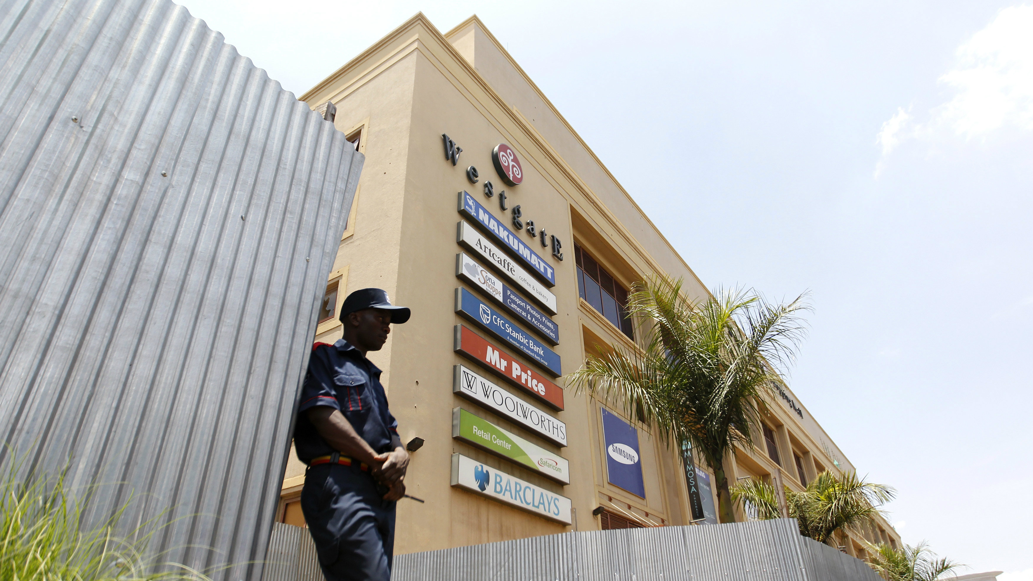 A security guard stands outside the Westgate shopping mall that has been left deserted following last year's attack by gunmen in Nairobi.