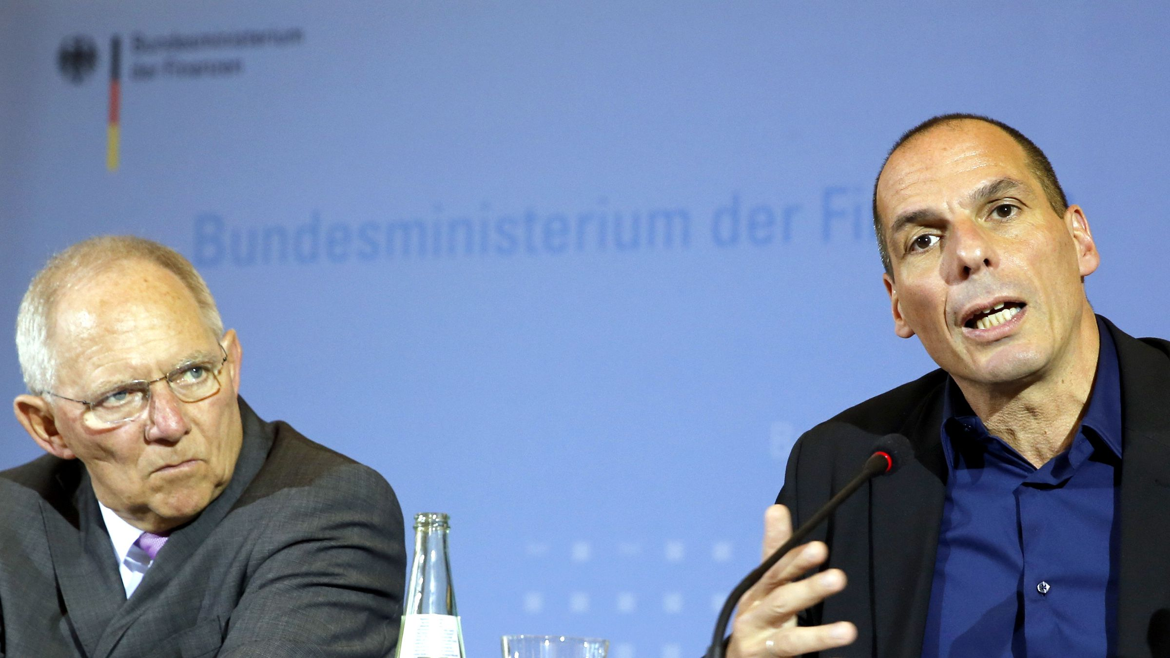 """Greek Finance Minister Yanis Varoufakis and German Finance Minister Wolfgang Schaeuble (L) address a news conference following talks at the finance ministry in Berlin February 5, 2015. The Greek and German finance ministers could """"not even agree to disagree"""" at their meeting on Thursday about the new government in Athens' plans to renegotiate Greece's debt and halt austerity measures prescribed by Berlin, the Greek minister said."""