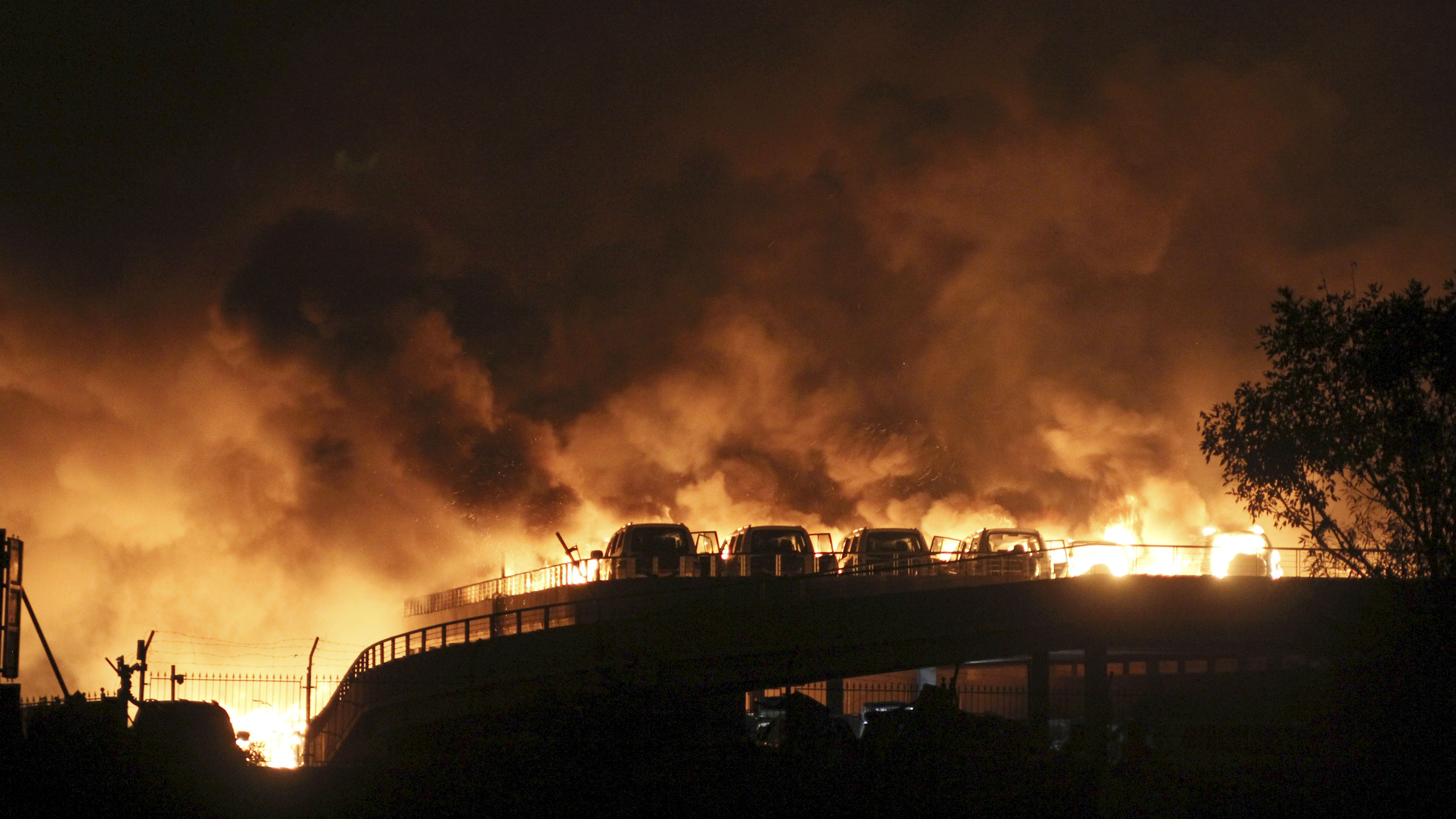 Vehicles are seen burning after blasts at Binhai new district in Tianjin municipality, China, August 13, 2015. Huge explosions hit an industrial area in the northeast Chinese port city of Tianjin, triggering a blast wave felt kilometers away and injuring scores of people, Chinese media reported.