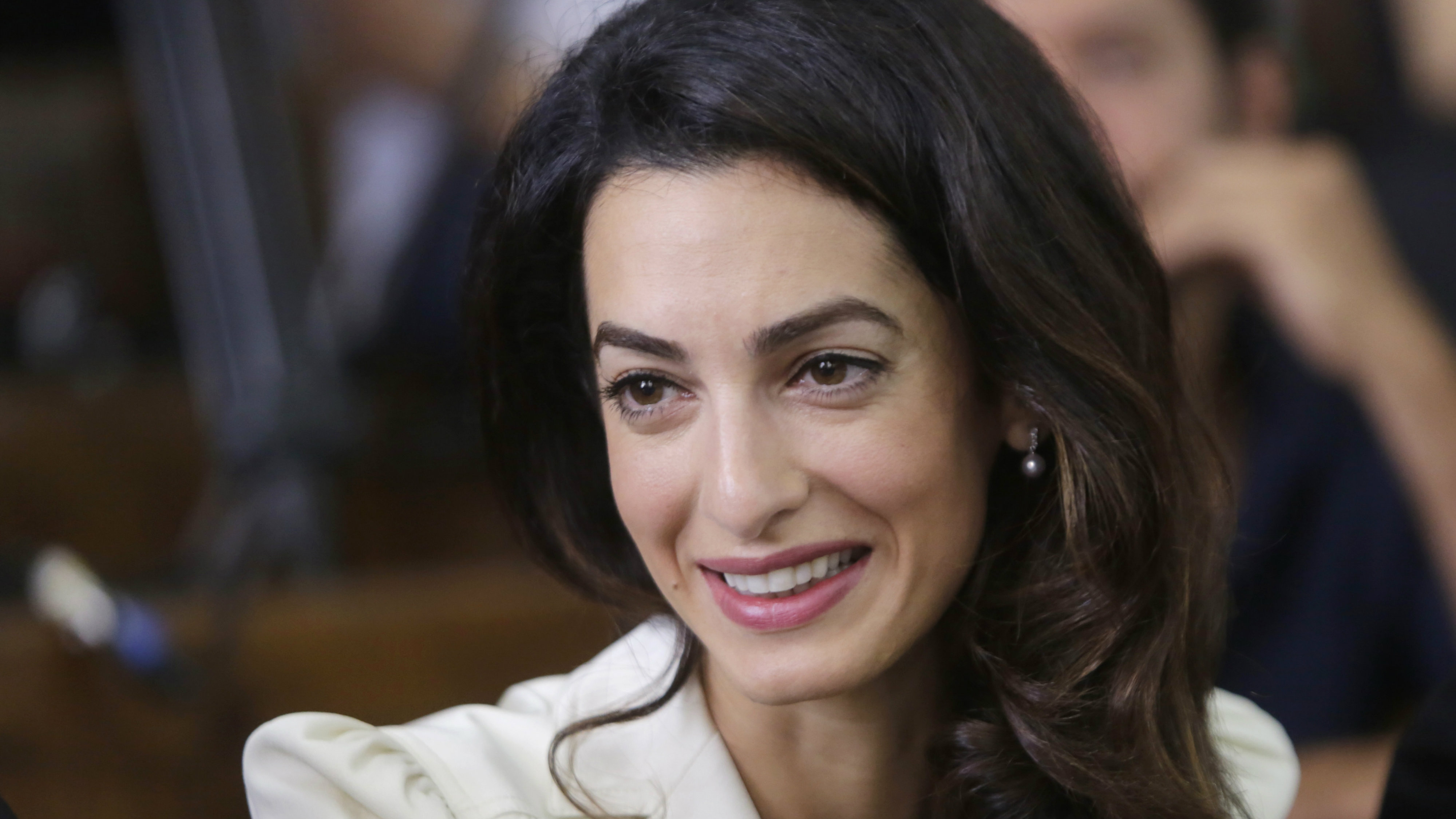 The Ap Describes Renowned Human Rights Lawyer Amal Clooney