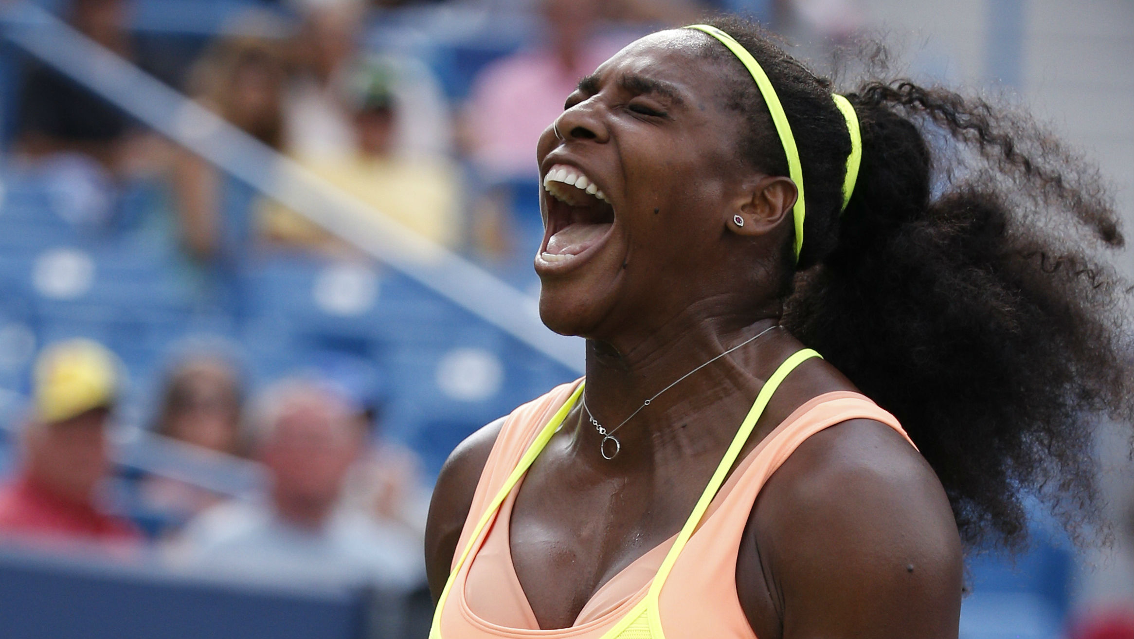 Serena Williams reacts during a final match against Simona Halep, of Romania, at the Western & Southern Open tennis tournament, Sunday, Aug. 23, 2015, in Mason, Ohio. Williams defeated Halep 6-3, 7-6 (5). (AP Photo/John Minchillo)