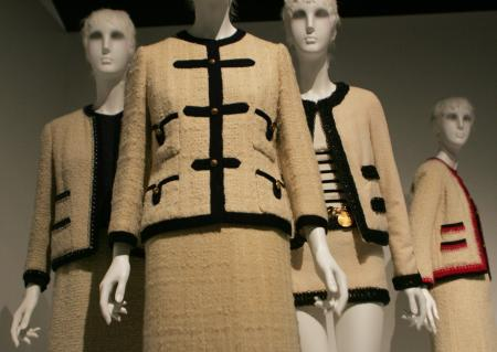"""Chanel suits from various decades are shown at the Metropolitan Museum of Art in New York, Monday, May 2, 2005. The suits are part of a new exhibit titled """"Chanel,"""" which opens May 5, organized by the Costume Institute."""