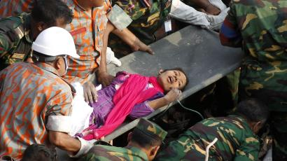 In this Friday, May 10, 2013 photo, survivor of a building collapse Reshma Begum lies on a stretcher after being pulled out from the rubble of a building that collapsed in Saver, near Dhaka, Bangladesh. The seamstress who survived 17 days before being rescued from a collapsed garment factory building was exhausted, panicked and dehydrated as she recovered in a Bangladeshi hospital Saturday, but she was generally in good shape, according to her doctors.