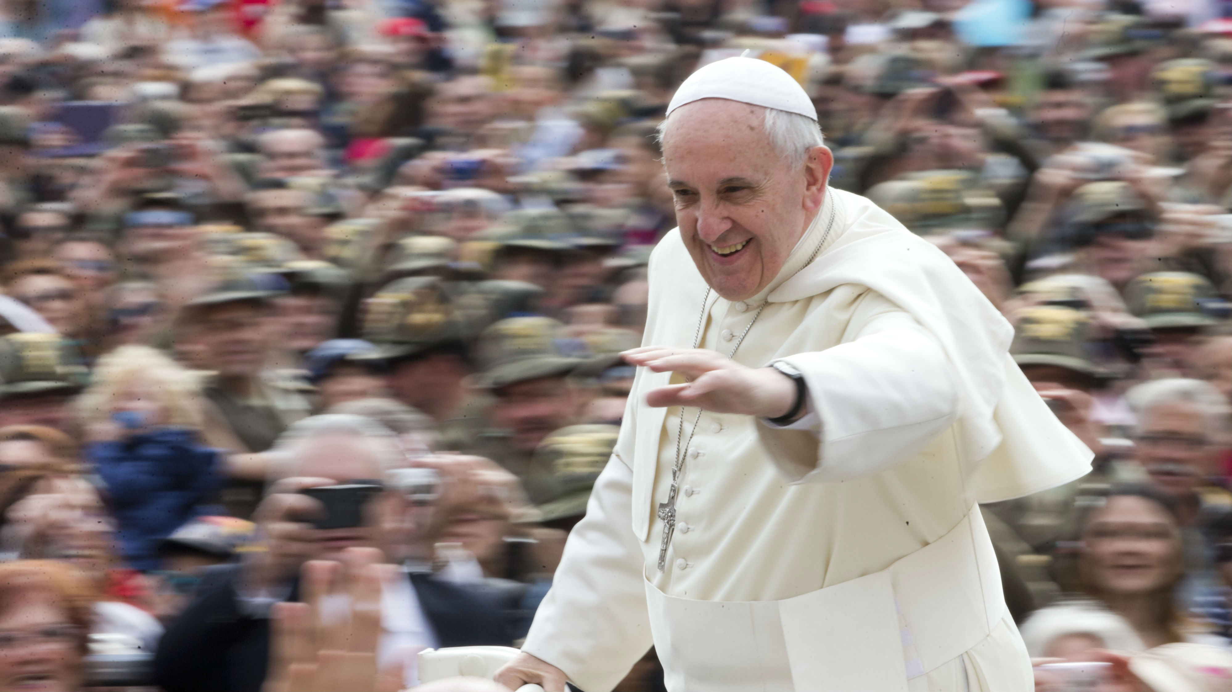 Pope Francis waves as he arrives for his weekly general audience in St. Peter's Square at the Vatican, Wednesday, May 7, 2014. (AP Photo/Alessandra Tarantino)