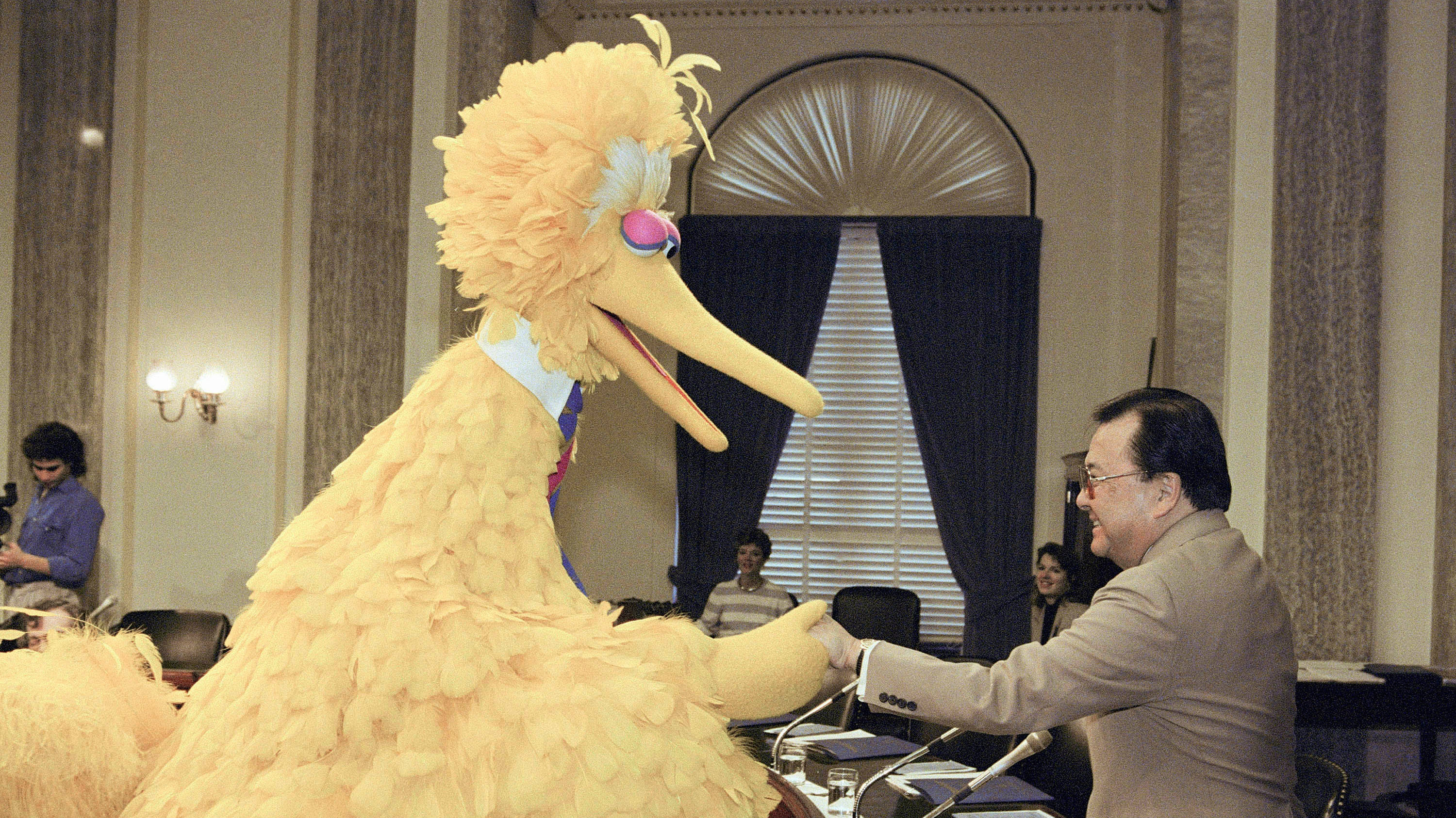 Big Bird, of the educational television show Sesame Street, shakes hands with Sen. Daniel Inouye, D-Hawaii, chairman of the Senate Commerce Science and Transportation Communications subcommittee on Capitol Hill in Washington, on April 12, 1989. The subcommittee is holding hearings on competitiveness in educational children's television. (AP Photo/John Duricka)