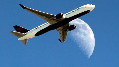 Delta Airlines flight flies by moon