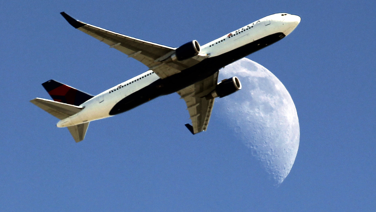 Delta Airlines flight DL370 from Managua Nicaragua  crosses over a waxing crescent moon as it passes over Whittier, Calif. on approach to the Los Angeles Airport (LAX) on Labor Day, Monday, Sept. 1, 2014.
