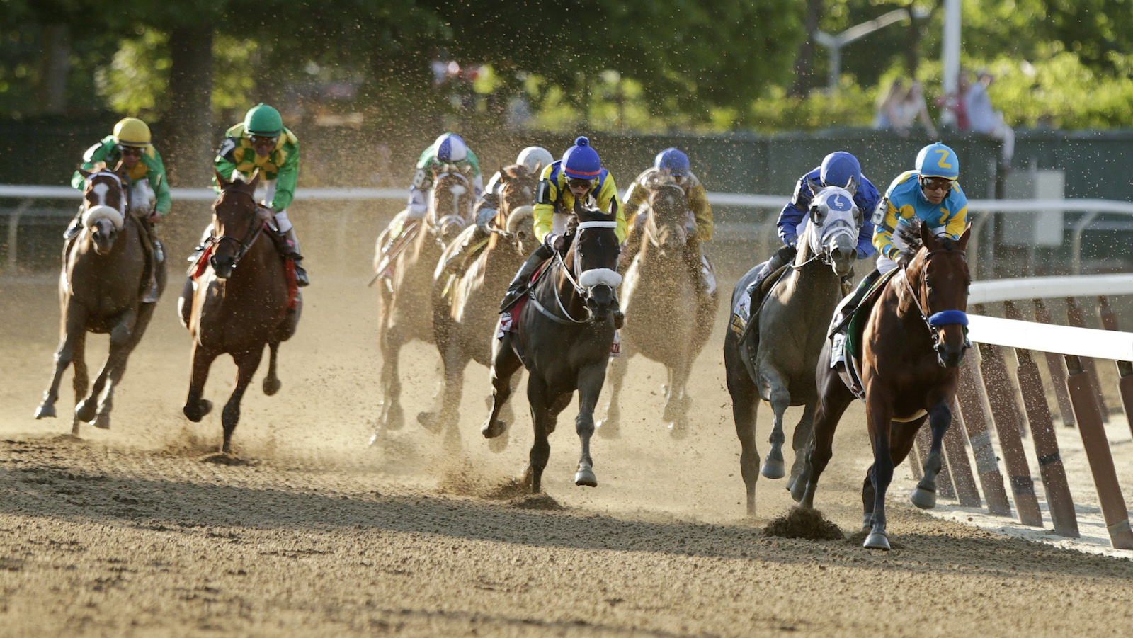 American Pharoah, with Victor Espinoza up,  rounds the fourth turn at the 147th running of the Belmont Stakes horse race Saturday, June 6, 2015, in Elmont, N.Y. American Pharoah led all the way to win the Belmont Stakes by 5 ½ lengths on Saturday, becoming the first horse in 37 years to sweep the Kentucky Derby, Preakness and Belmont Stakes - one of the sporting world's rarest feats.