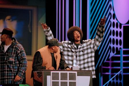 Dr. Dre and Snoop Doggy Dogg react after Dre won favorite artist and new artist in rap-hip hop at the 21st annual American Music Awards in Los Angeles, Feb. 7, 1994.