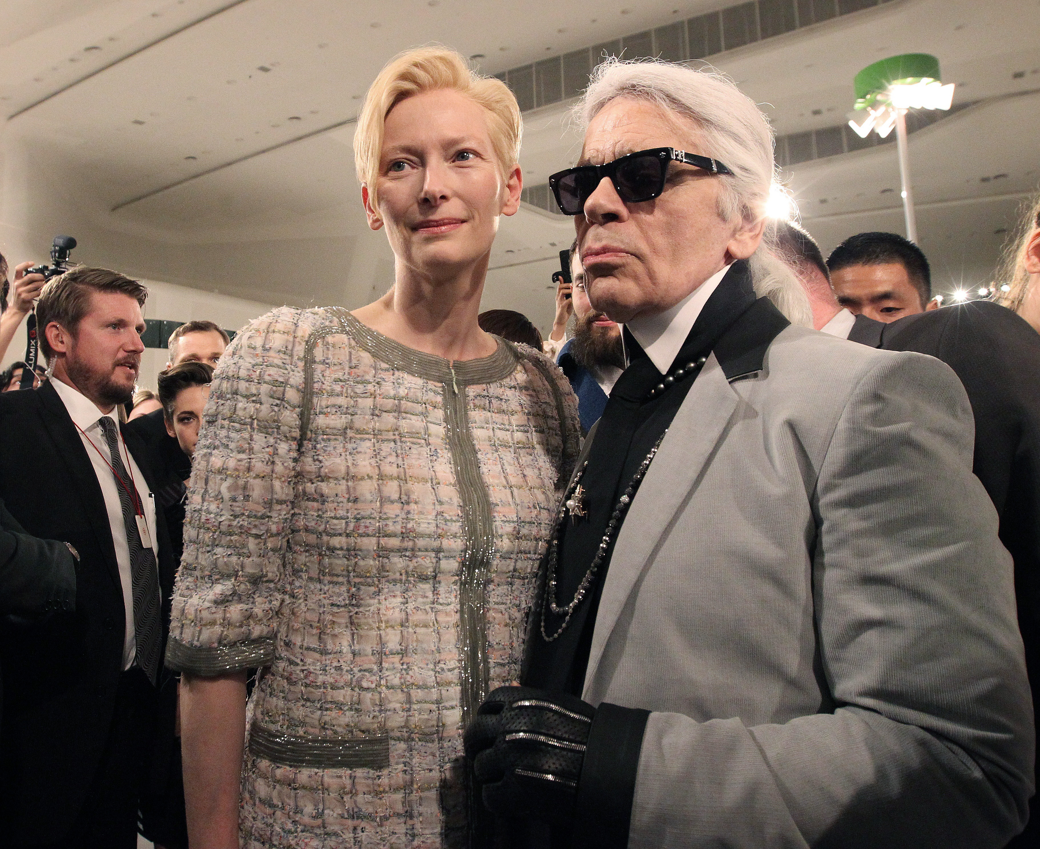 German fashion designer Karl Lagerfeld, right, poses with British actress Tilda Swinton after the presentation of his 2015-2016 Chanel cruise collection at the Dongdaemun Design Plaza in Seoul, South Korea, Monday, May 4, 2015.