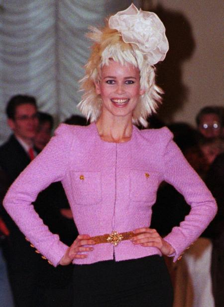 German top model Claudia Schiffer wears a pink top with a black long skirt as part of Chanel's 1996 spring/summer haute couture collection designed by Germany's Karl Lagerfeld and presented in Paris Tuesday January 23, 1996.