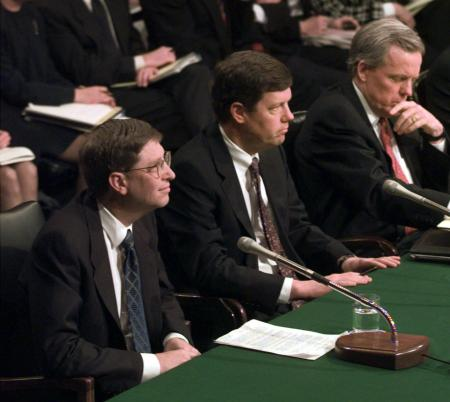 Microsoft President Bill Gates, left, along with Sun Microsystems President Scott McNealy, center, and Netscape Communication President Jim Barksdale testify before the Senate Judiciary Committee hearing on anticompetitive issues and technology on Capitol Hill Tuesday March 3, 1998. A marriage of America Online and Netscape would create a single Internet company with remarkable reach across the high-tech world _ enough influence even to challenge Microsoft's dominance in key areas. Officials from AOL and Netscape continue talking Monday, Nov. 23, 1998, in an effort to reach a deal. (AP Photo/File, Joe Marquette)