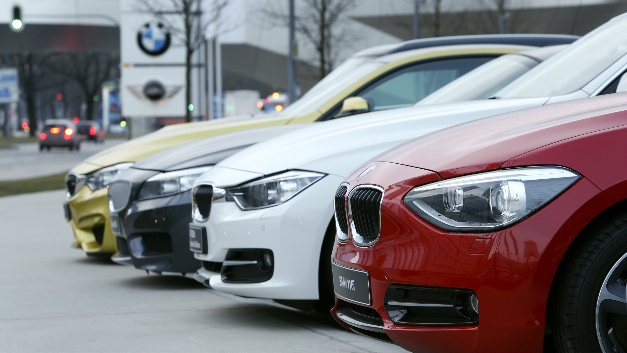 bmws in different colours are placed near the headquarters of german luxury car maker bmw in