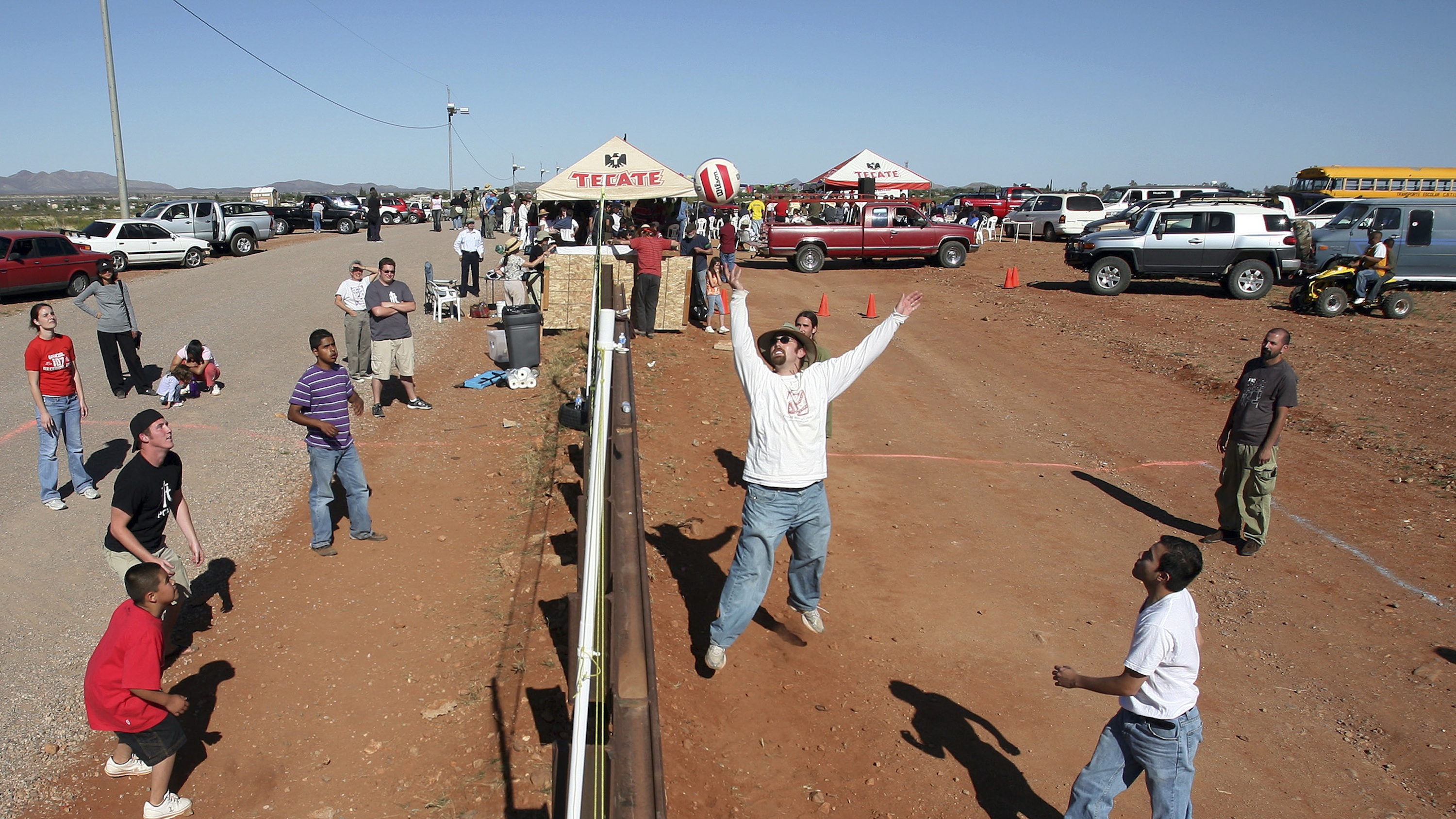 Locals are using the US-Mexico border fence as a giant volleyball net