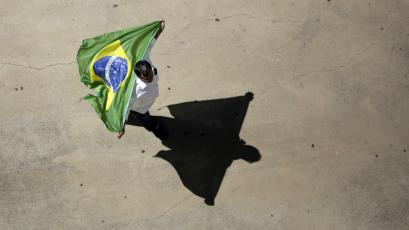 A demonstrator attends an August 2015 protest against Brazil's President Dilma Rousseff.