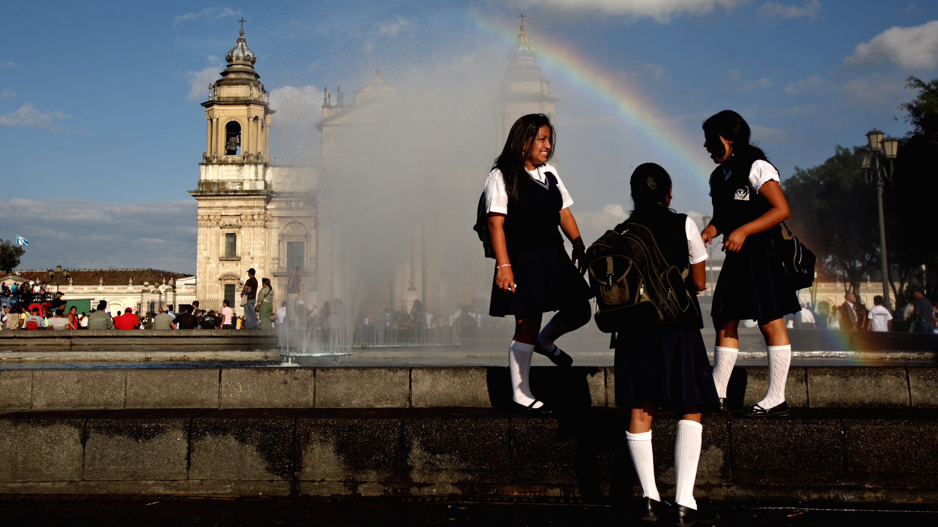 Schoolgirls talk near a fountain at the Parque Central in Guatemala City. In Guatemala, 30% of women are married by the age of 18.