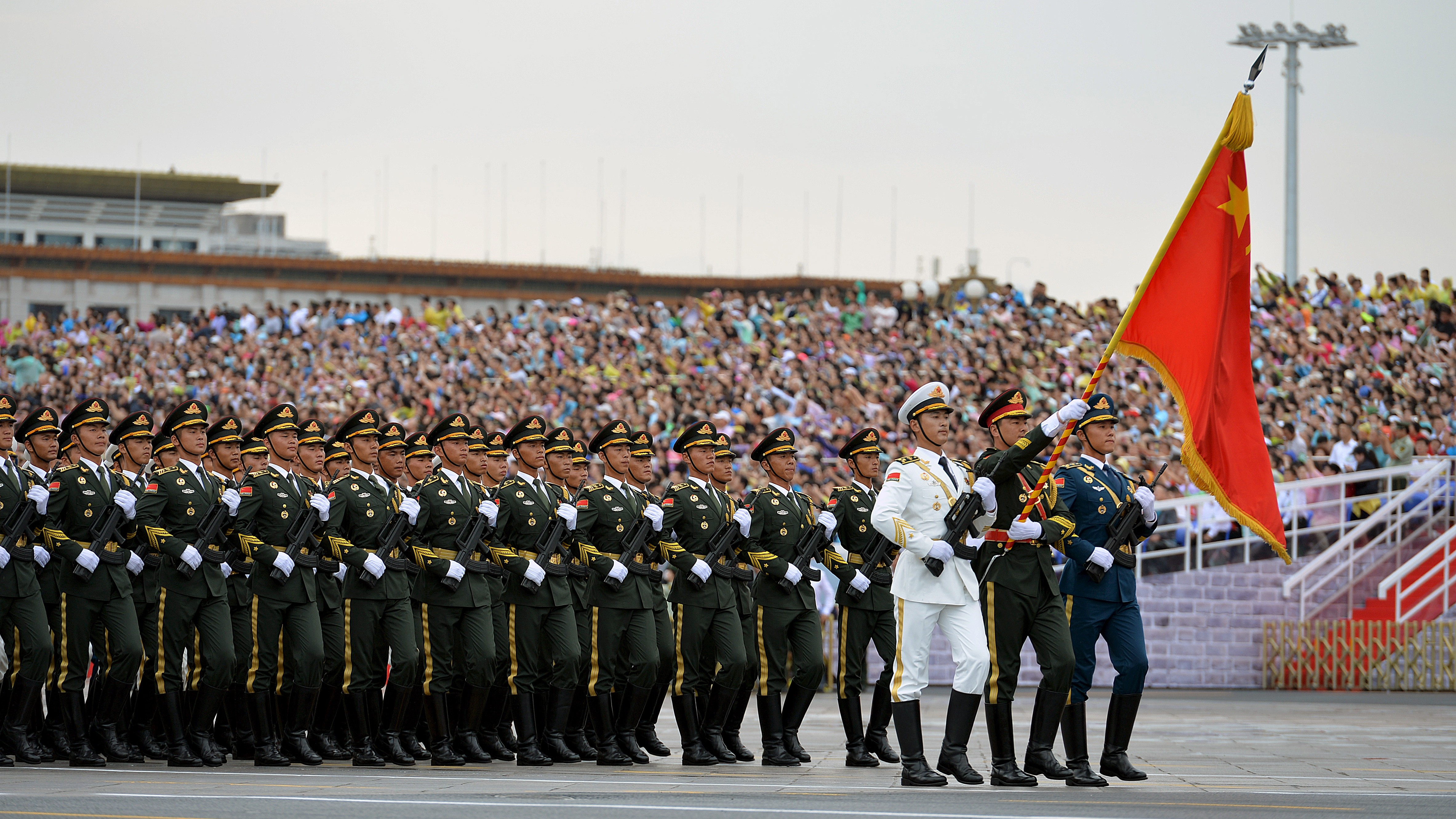 Soldiers of China's People's Liberation Army (PLA) march during a rehearsal for a military parade in Beijing, August 23, 2015. Troops from at least 10 countries including Russia and Kazakhstan will join an unprecedented military parade in Beijing next month to commemorate China's victory over Japan during World War Two, Chinese officials said. The parade on Sept. 3 will involve about 12,000 Chinese troops and 200 aircraft, Qi Rui, deputy director of the government office organizing the parade, told reporters in Beijing on Friday.