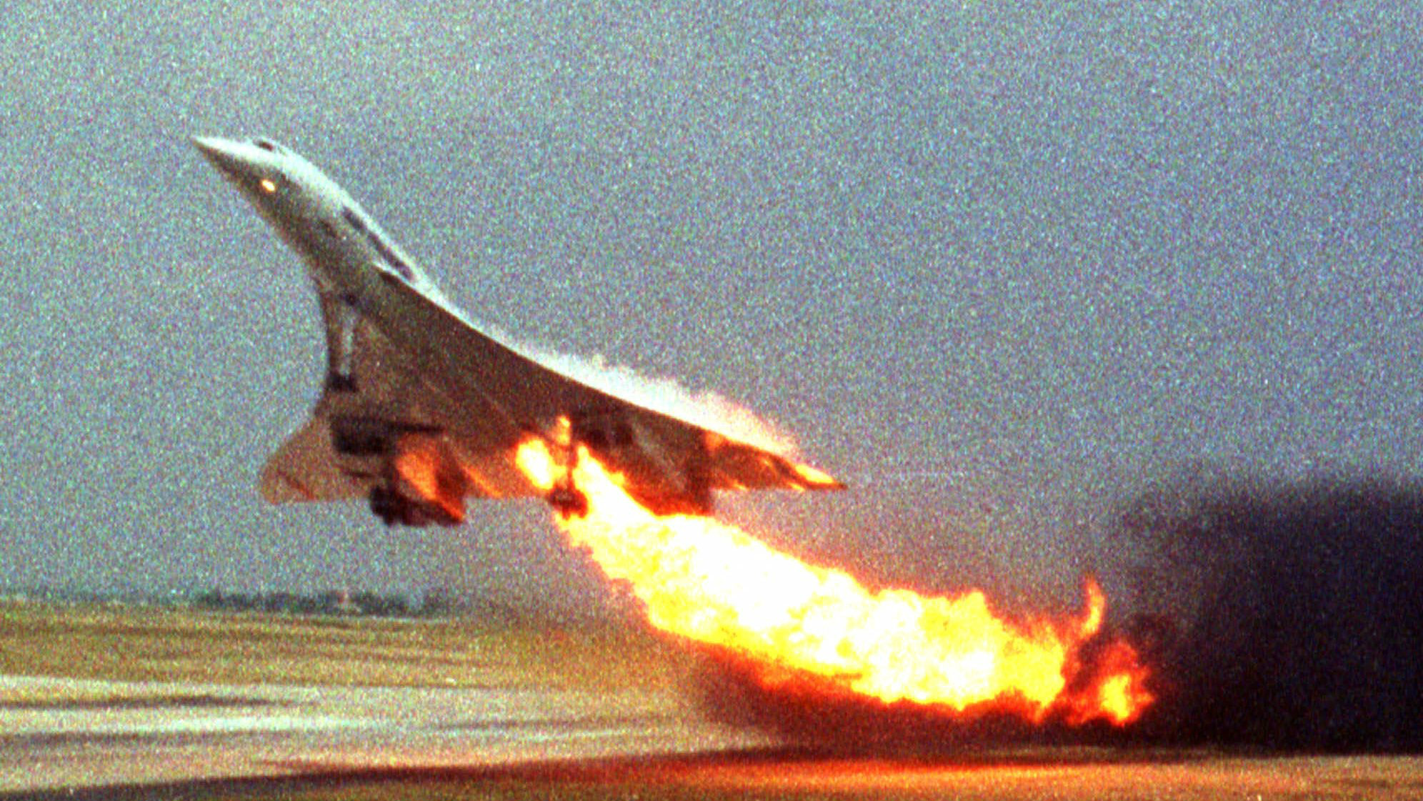 Air France Concorde flight 4590 takes off with fire trailing from its engine on the left wing from Charles de Gaulle airport in Paris, in this July 25, 2000 file photo.