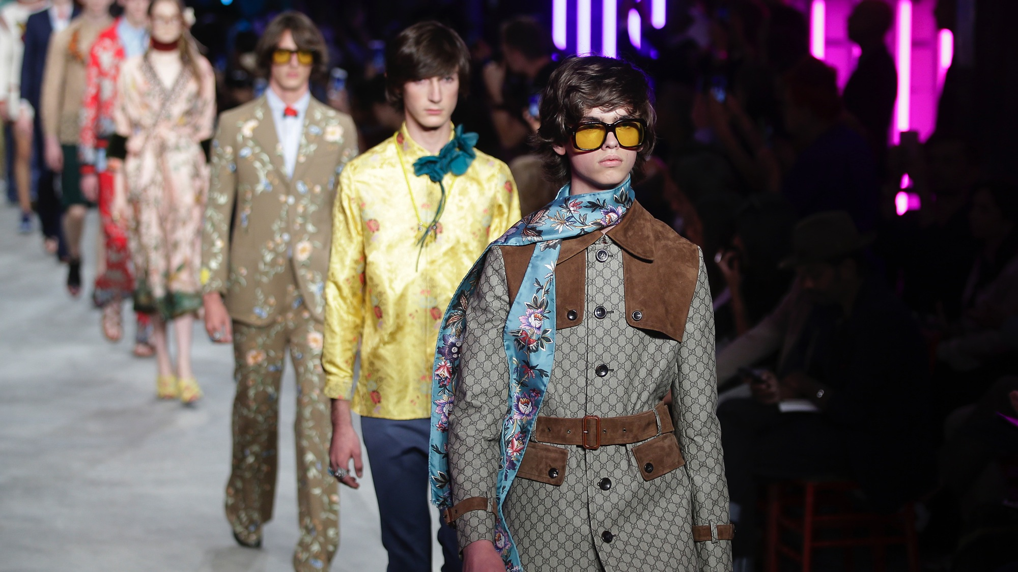 Models wear creations for Gucci men's Spring-Summer 2016 collection, part of the Milan Fashion Week, unveiled in Milan, Italy, Monday, June 22, 2015. (AP Photo/Antonio Calanni)