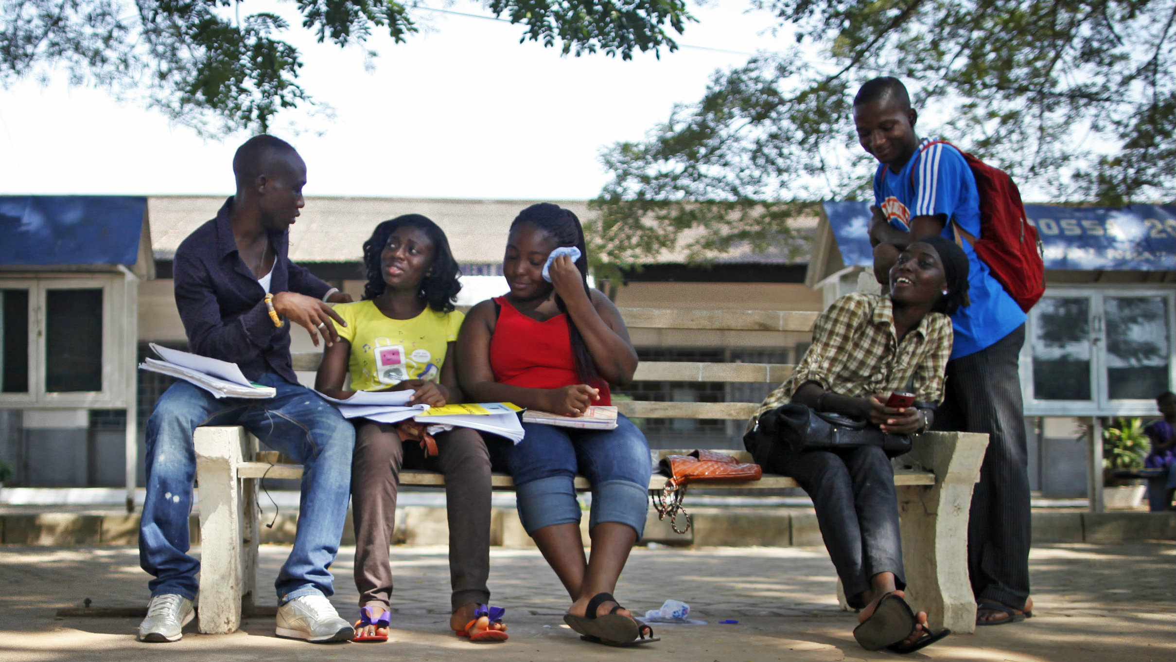In this Tuesday, Nov. 20, 2012 photo, political science students Abdul Jalil Ykbu, background left, discusses work with fellow students at the University of Ghana in Accra, Ghana. (AP Photo/Gabriela Barnuevo)