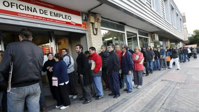 Members of the public form a huge line outside an employment agency in Madrid, Spain.