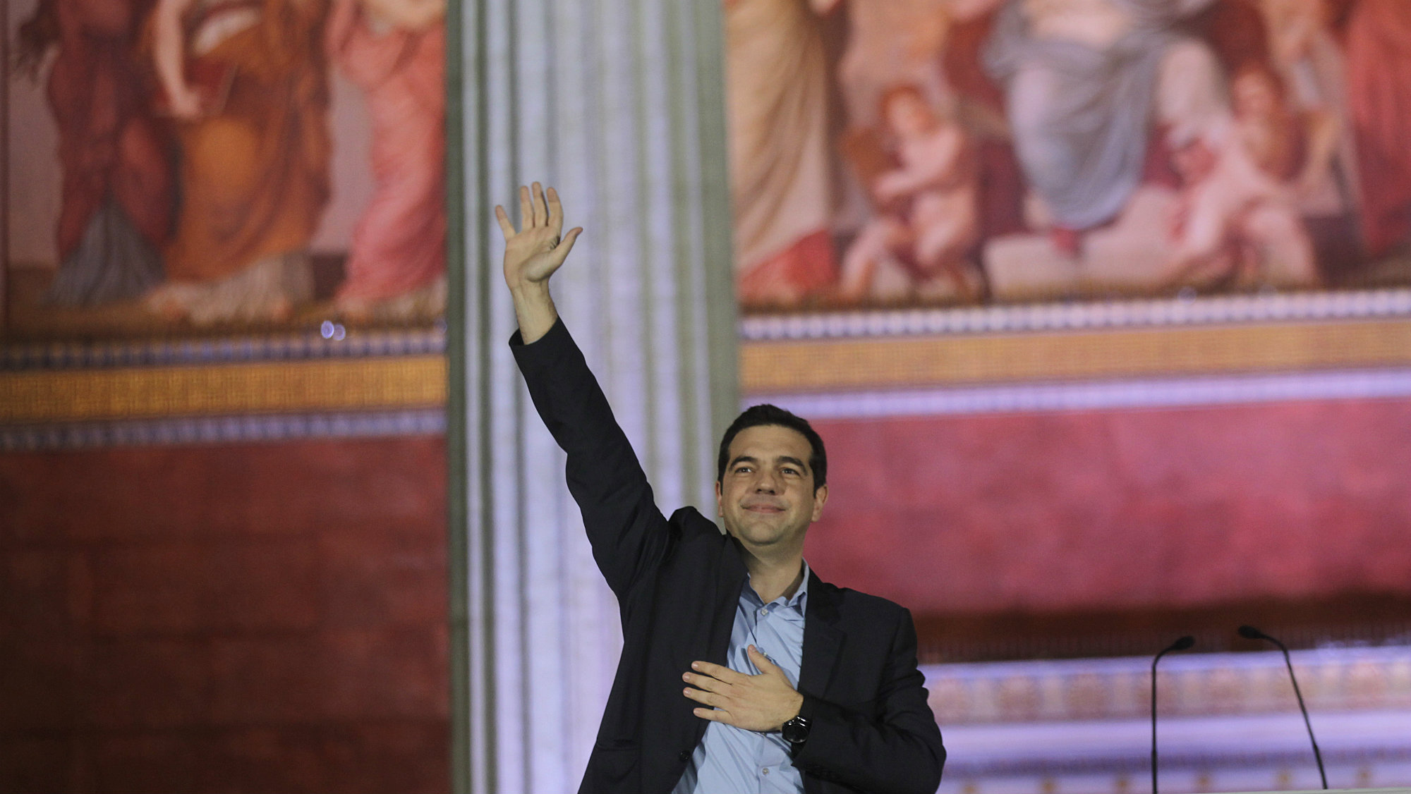 Alexis Tsipras, leader and head of radical leftist Syriza party, greets supporters after the initial election results for the Greece general elections in Athens, Greece, 25 January 2015.