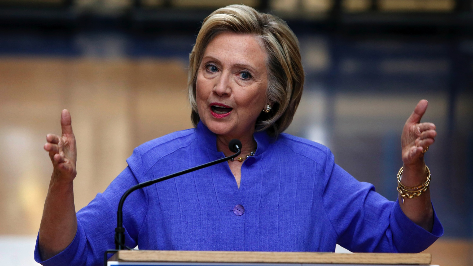 Democratic presidential candidate Hillary Rodham Clinton answers reporters questions about Republican presidential candidate Donald Trump after announcing her college affordability plan, Monday, Aug. 10, 2015, at the high school in Exeter, N.H. (AP Photo/Jim Cole)